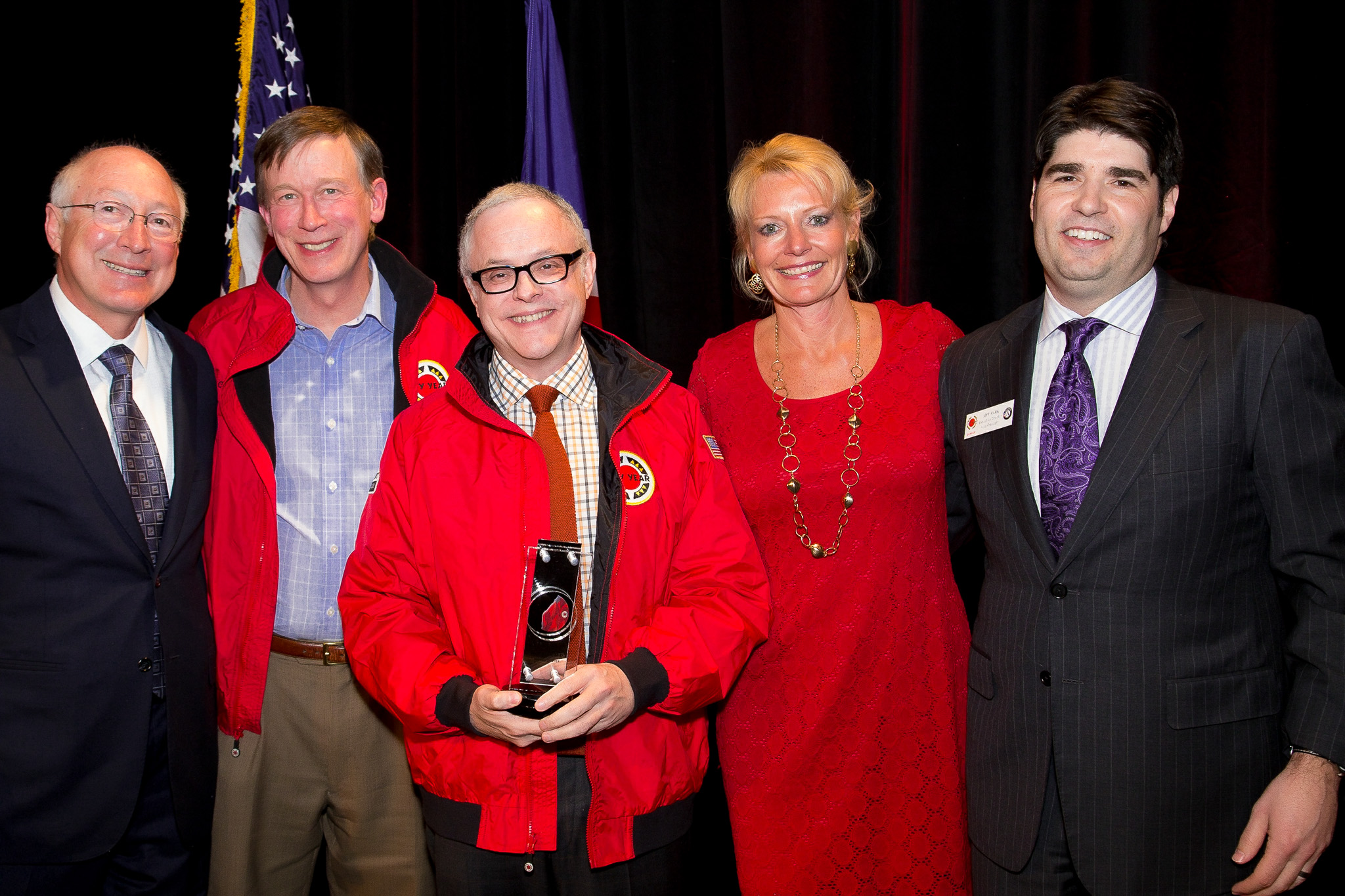 Surrounding Keynote Speaker  Neal Baer is (L-R) Former Secretary of The Interior, Ken Salazar, CO Gov. John Hickenlooper, Event Chair Jaquelin Lundquist and Jeff Park of City Year Denver