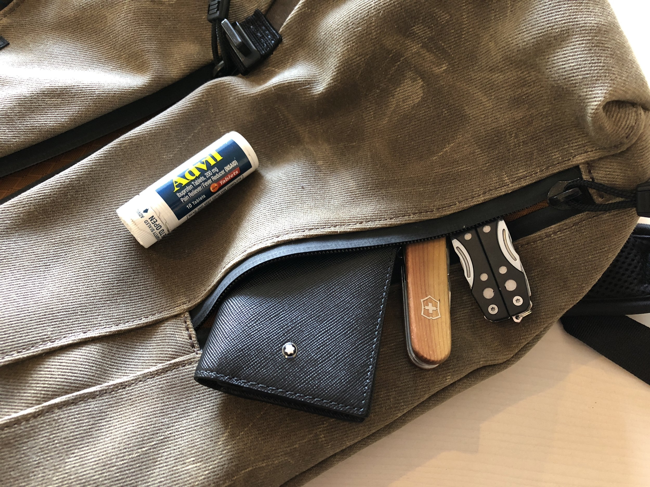 Outside pockets hold business cards, tools, a charger and Advil.