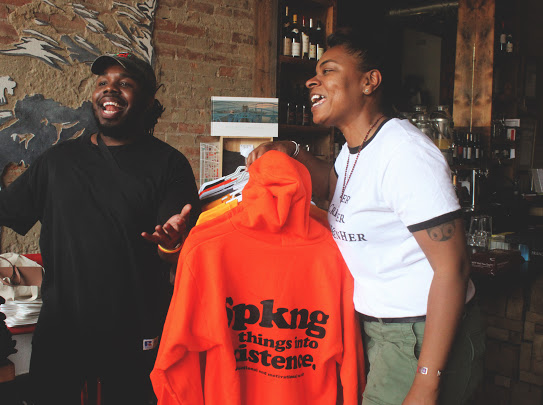 Ron owner ok SPKNG getting in a good laugh with Queen City Noire curator Erikka   Shop with Ron online www.spkngintongues.com