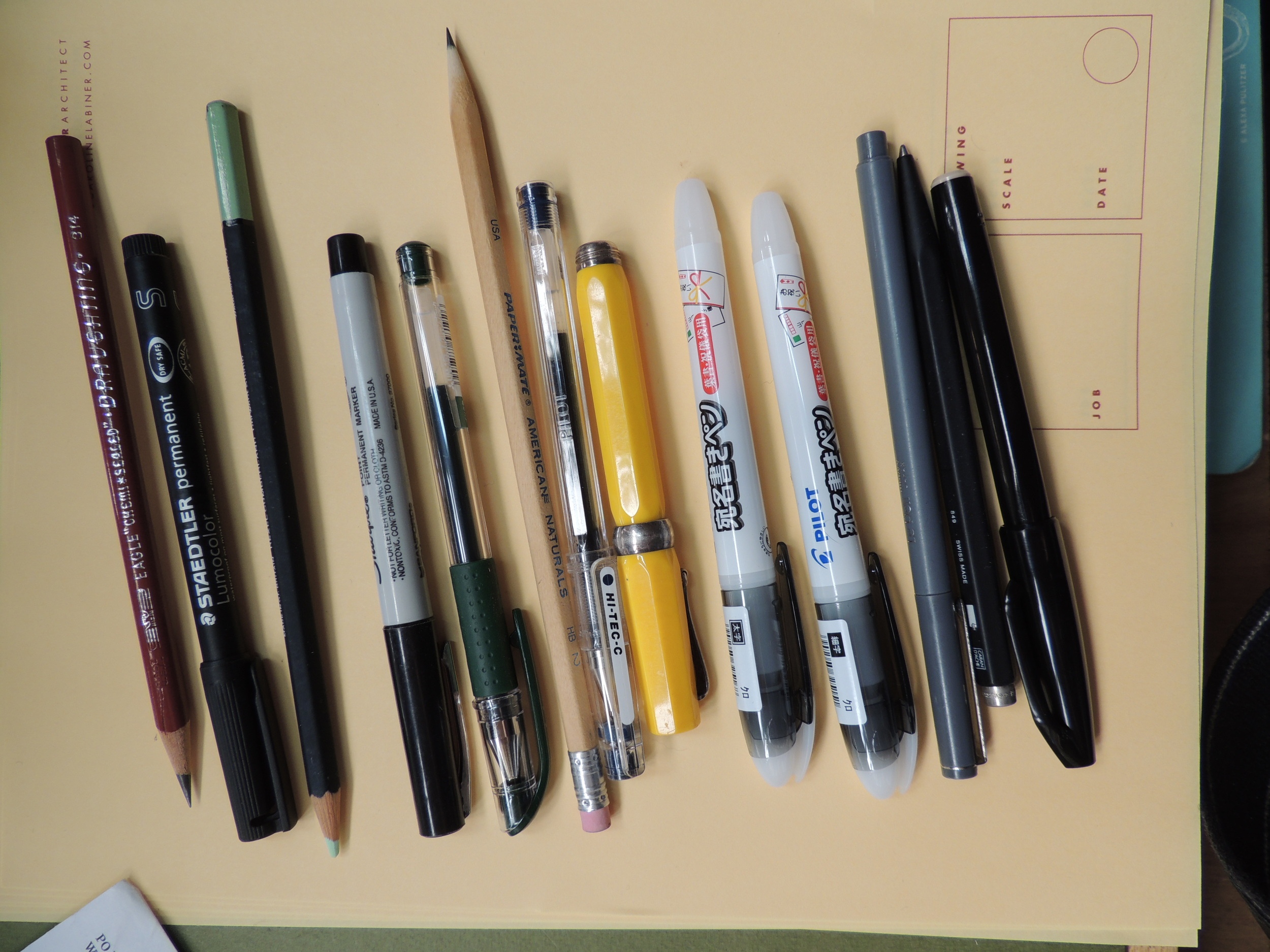 The pens and pencils on my desk. I am in love with Fine, Medium and Broad Pilot Envelope pens - not in small part because all the text is in Japanese. They are expressive and dry fast.  And do work beautifully on envelopes.