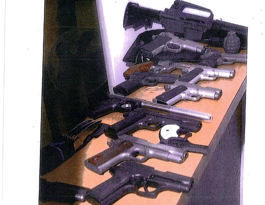 Guns secreted in a wall at Whitey's Santa Monica lair. Also recovered was $822,000 in cash.