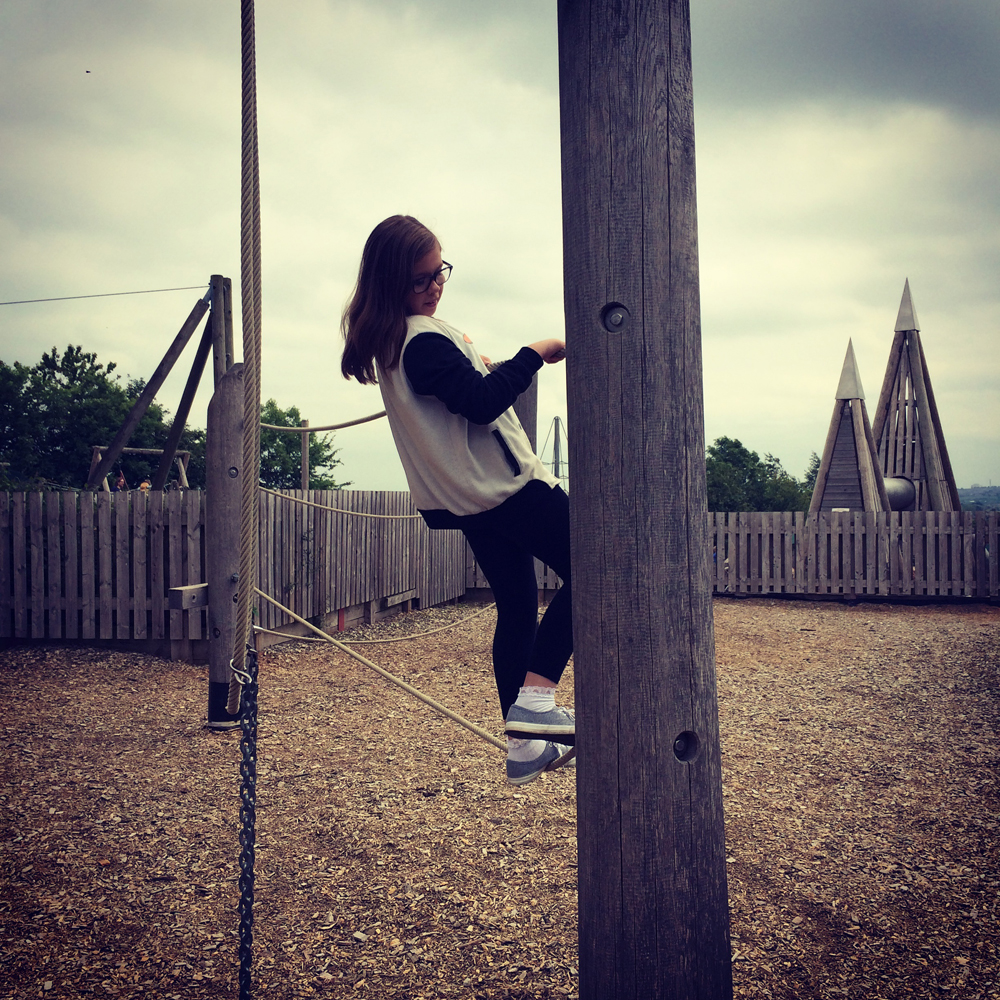 Amber enjoying climbing in the more challenging older kids play area at Cannon Hall Farm.
