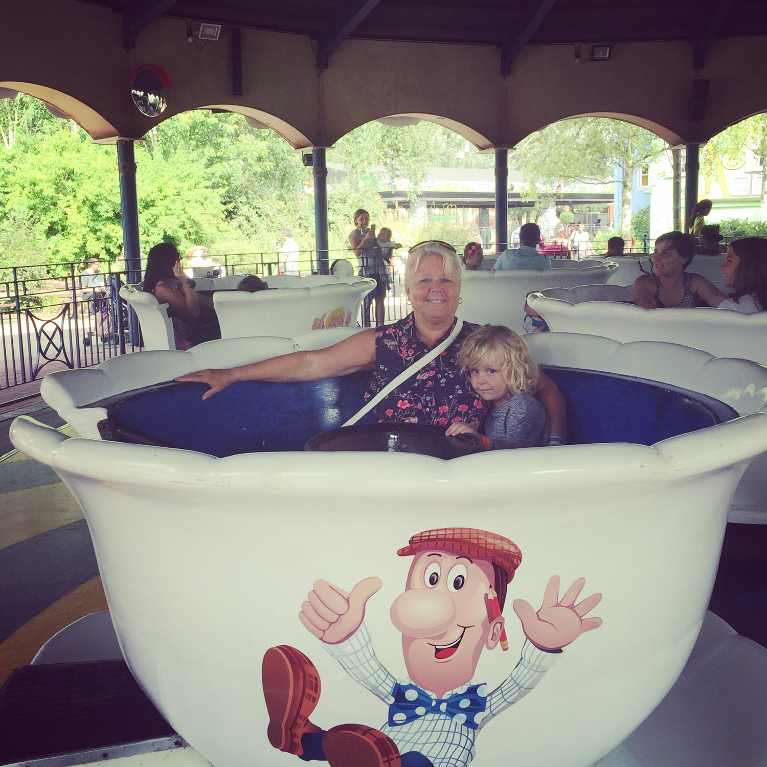 That's better! Jacob enjoying the teacups with his nonna at Thorpe Park Resort