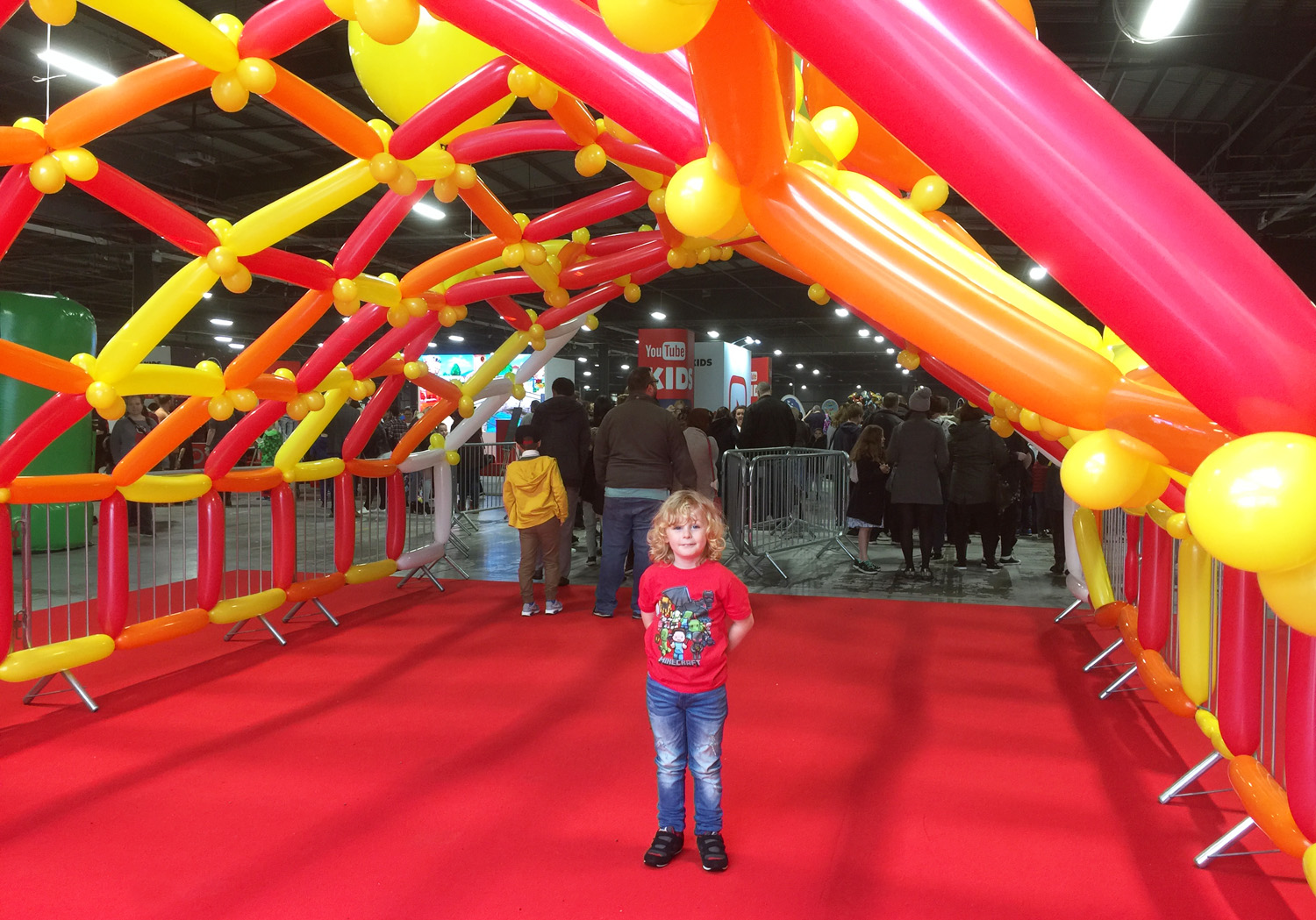 Jacob on the red carpet at the entrance to the Digital Kids Show