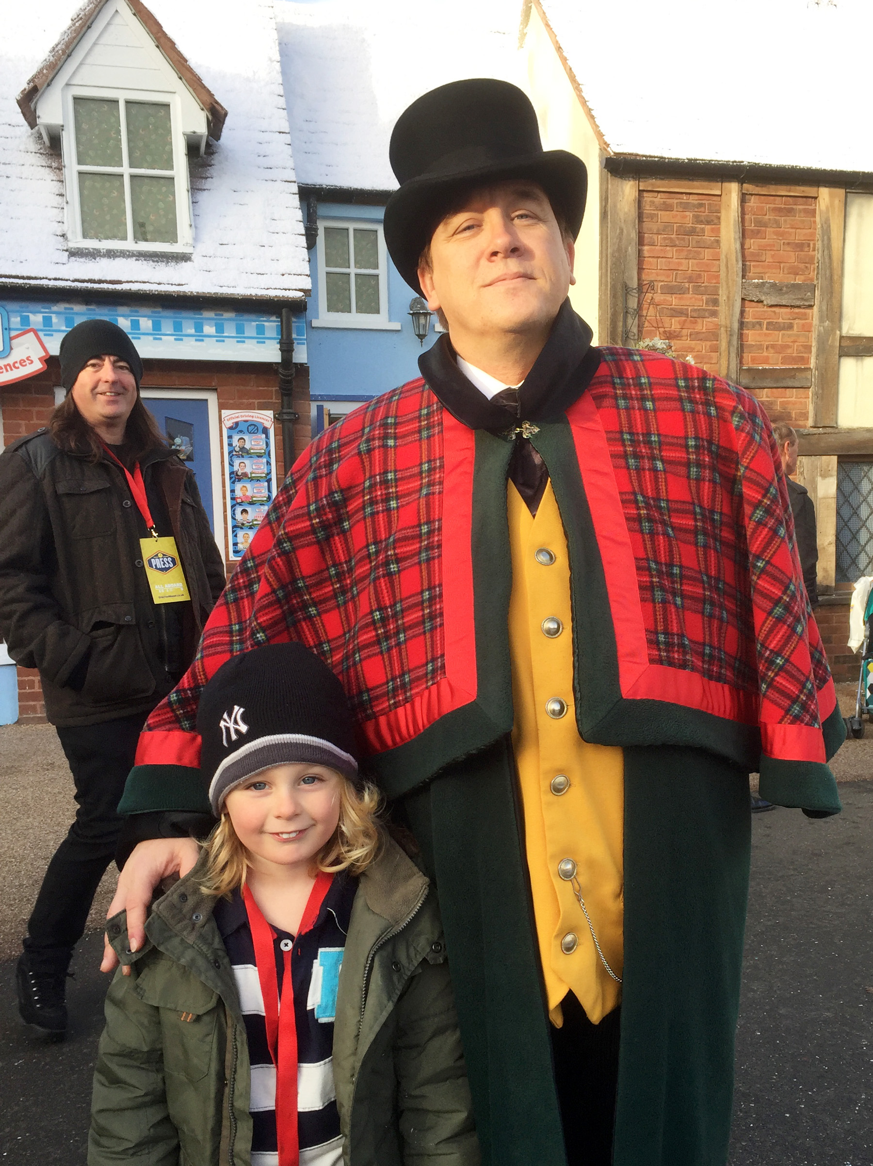 Jacob with the Fat Controller and daddy photobombing the picture!