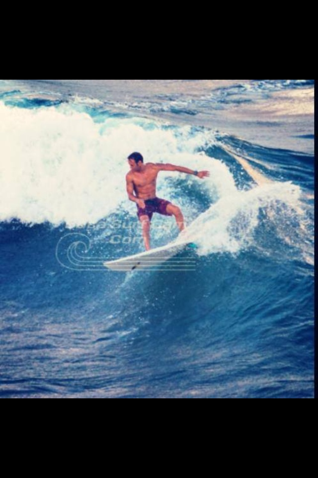 CrossFit HYPE / HYPE Weightlifting Gym Athlete ripping the surf at palmetto park beach in east Boca Raton.