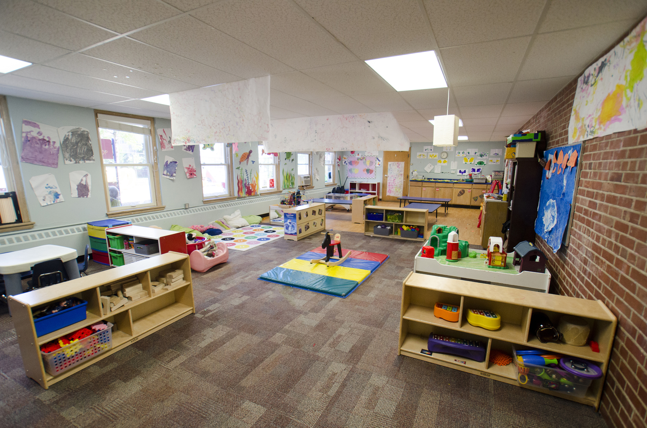 The toddler room is always changing--with artwork, pictures and interactive experiences made by the children.