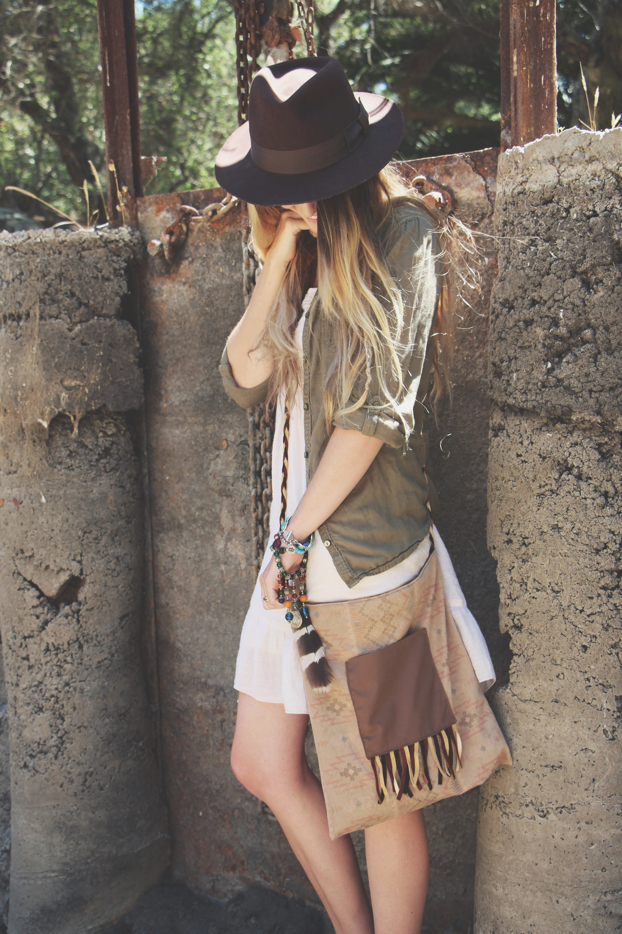 aztec print and braided leather bag. fedora hat free people street style ombre hairstyle