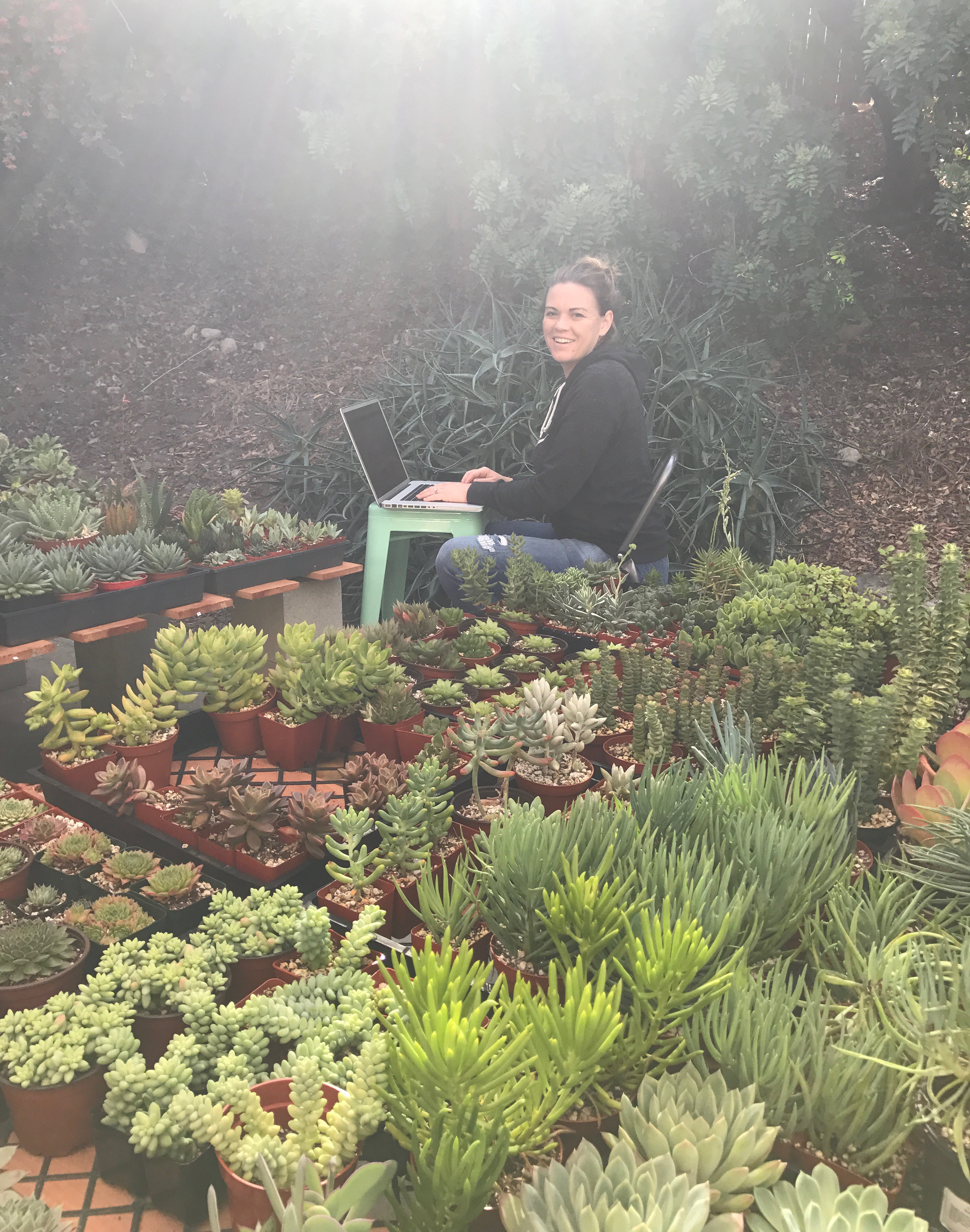 Krista taking inventory at our home nursery.