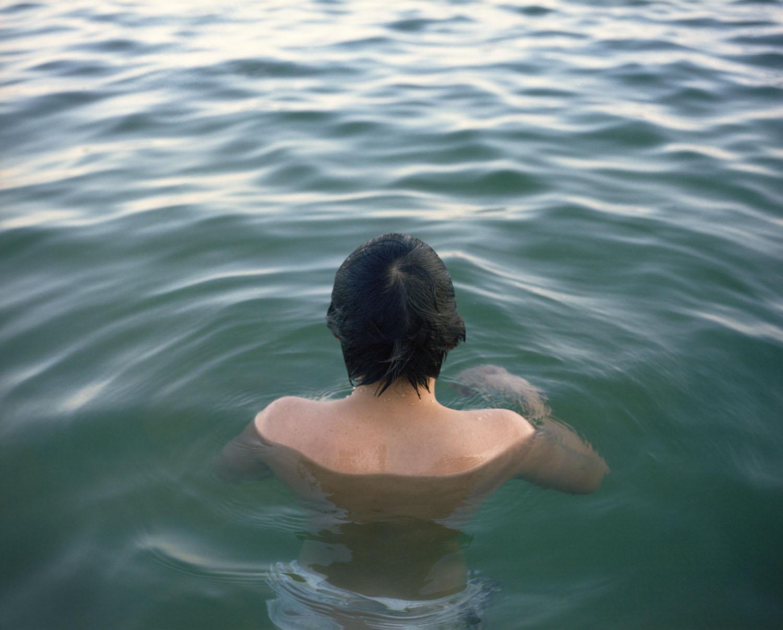 BoyinwaterWorking.jpg