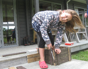 Jamie Lockwood builds a penguin nesting box.