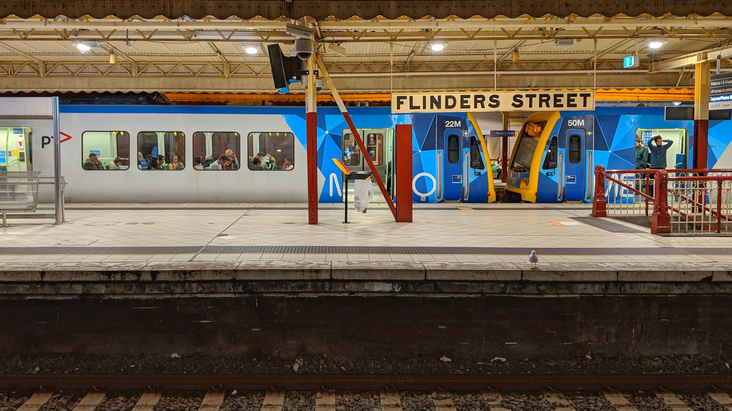 Waiting on a mostly empty platform at Flinders Street station.