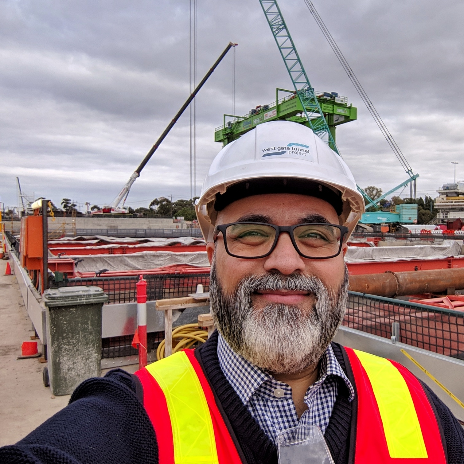 Wearing boots, a hard hat, and high visibility vest while touring the West Gate Tunnel Project northern portal (which is across the street from  Yarraville Gardens ).