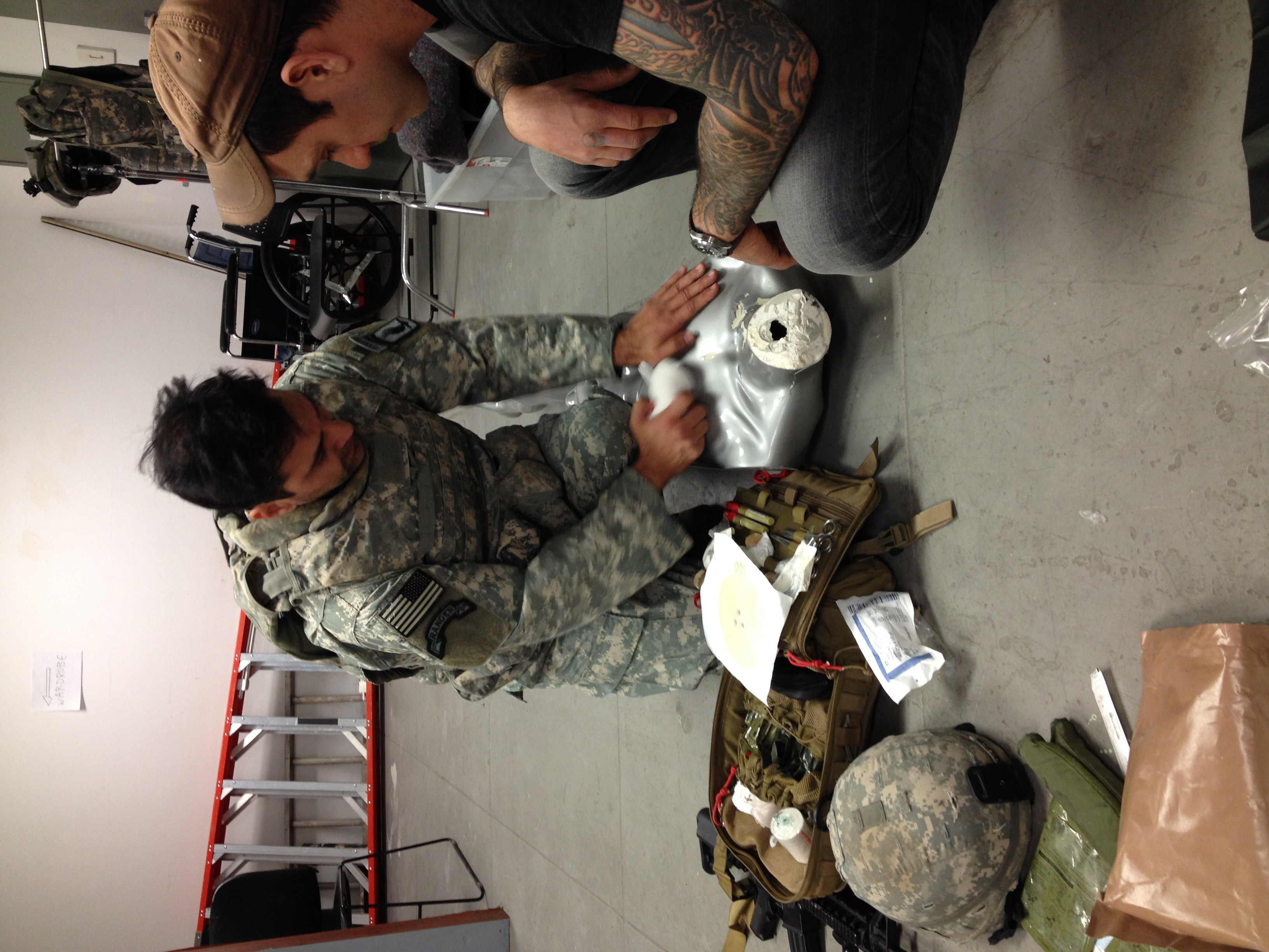 """Emil and Dion work on treating a """"casualty."""""""