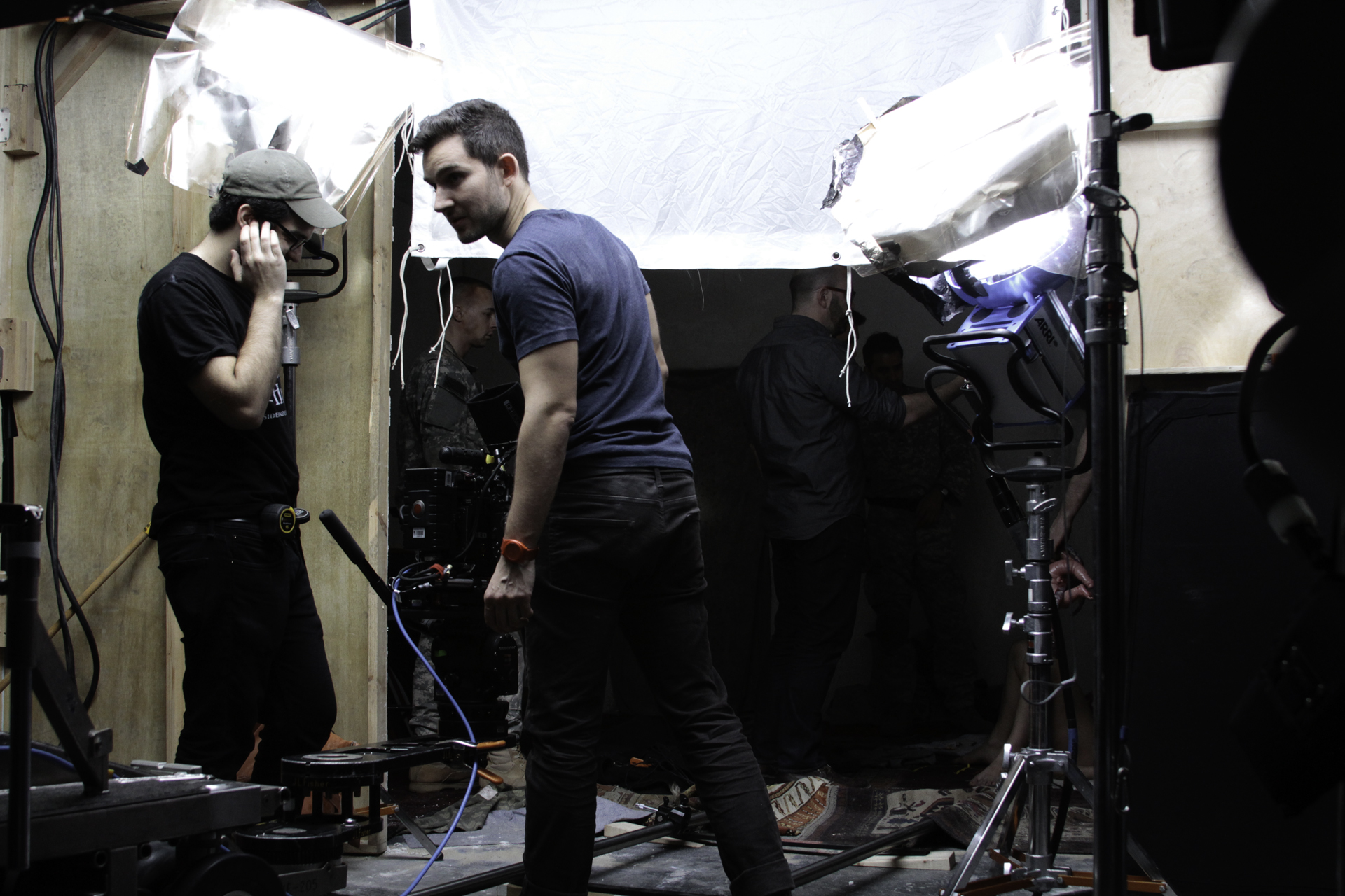 Director of Photography Laurence Vannicelli gives the crew lighting adjustment notes.