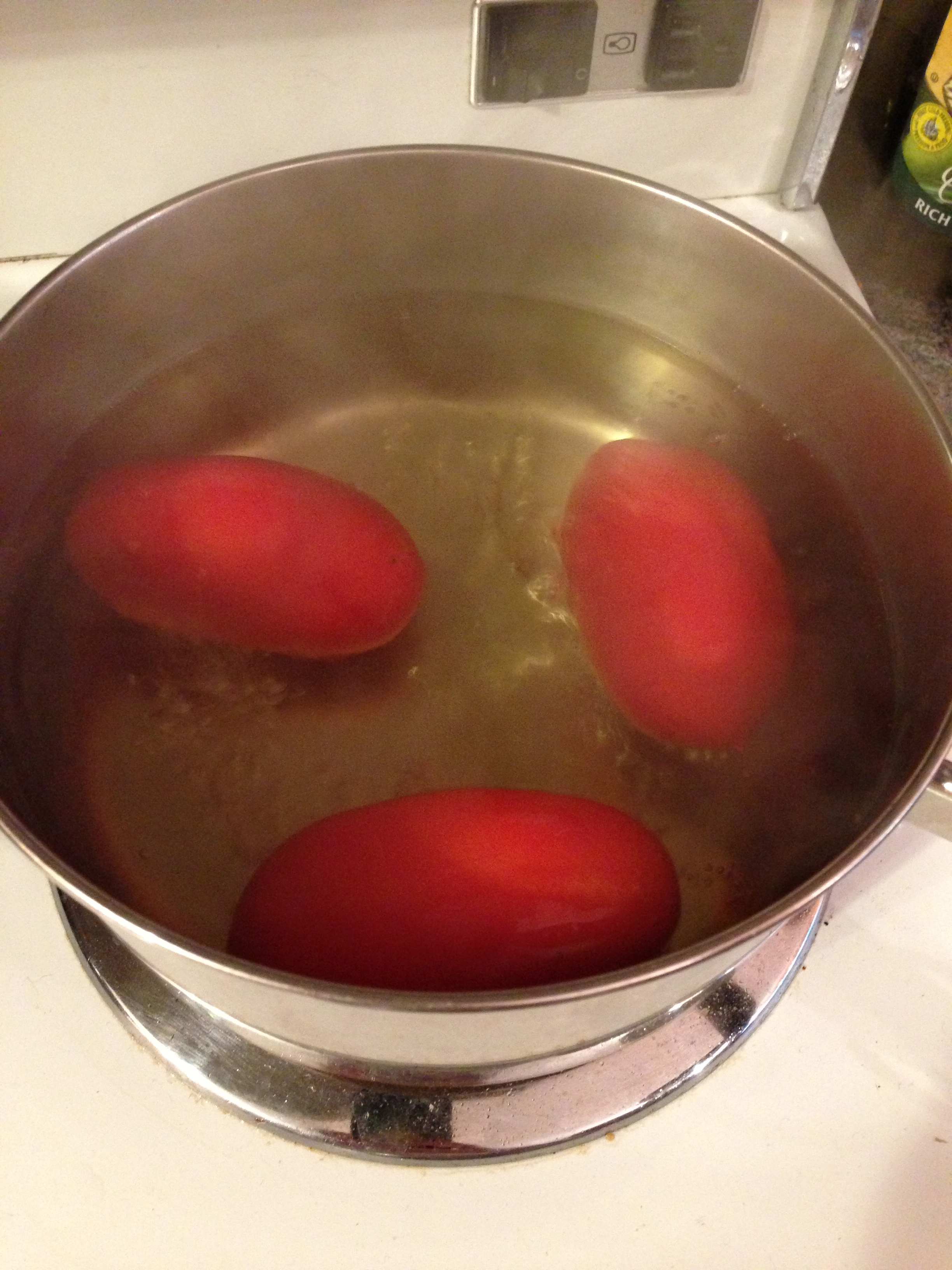 Blanching the tomatoes