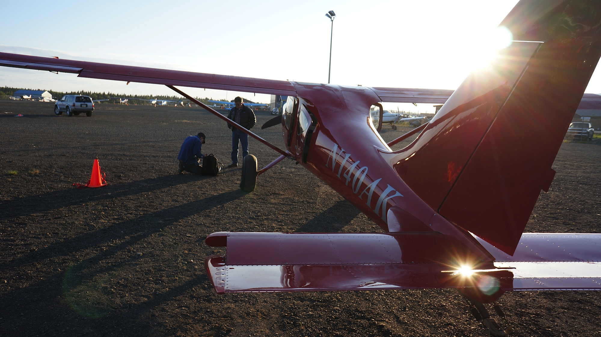Morning sun glints of Russell's plane