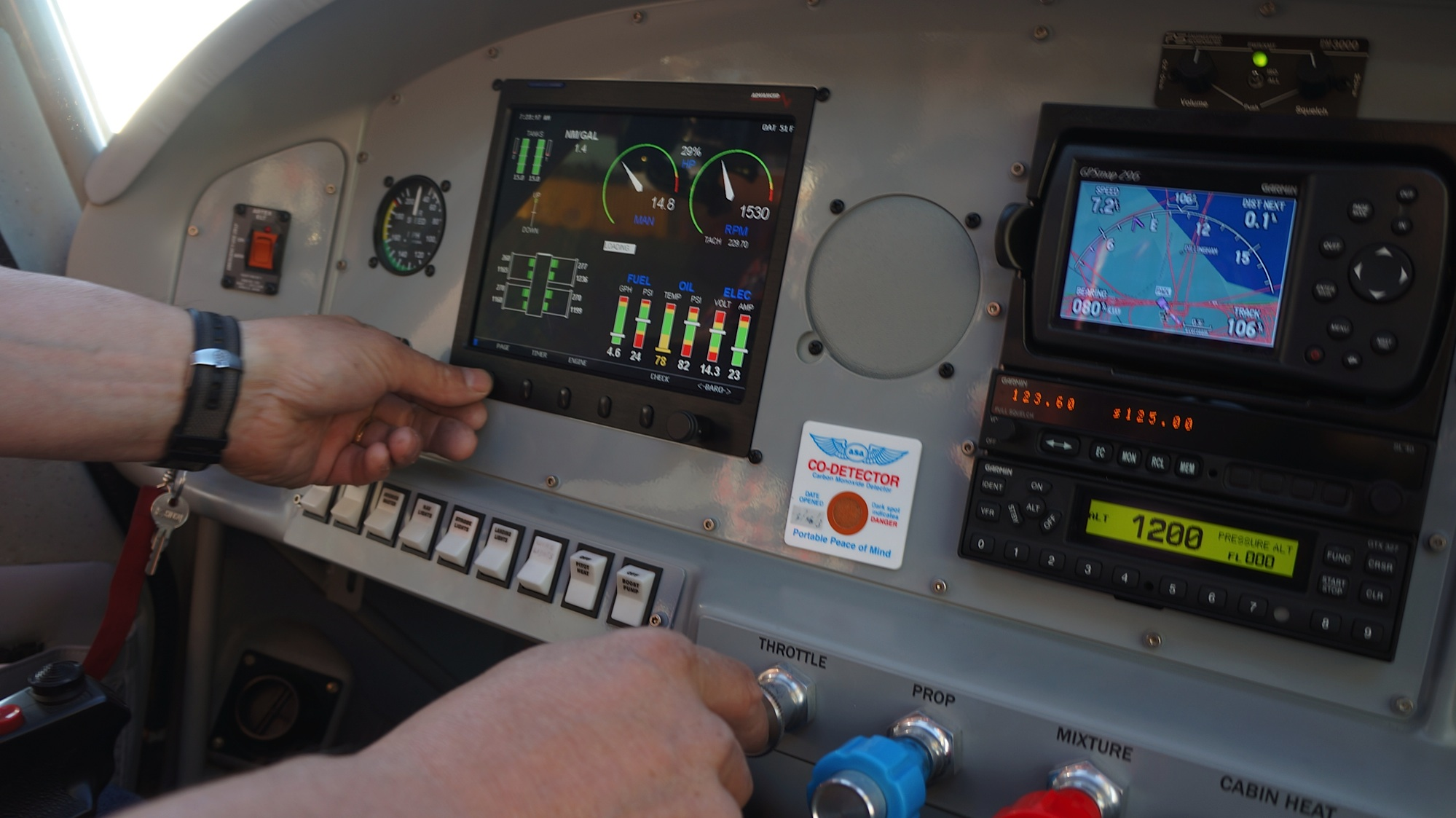 Control panel in the plane's dash, turn the key, flip some switches, adjust some knobs...