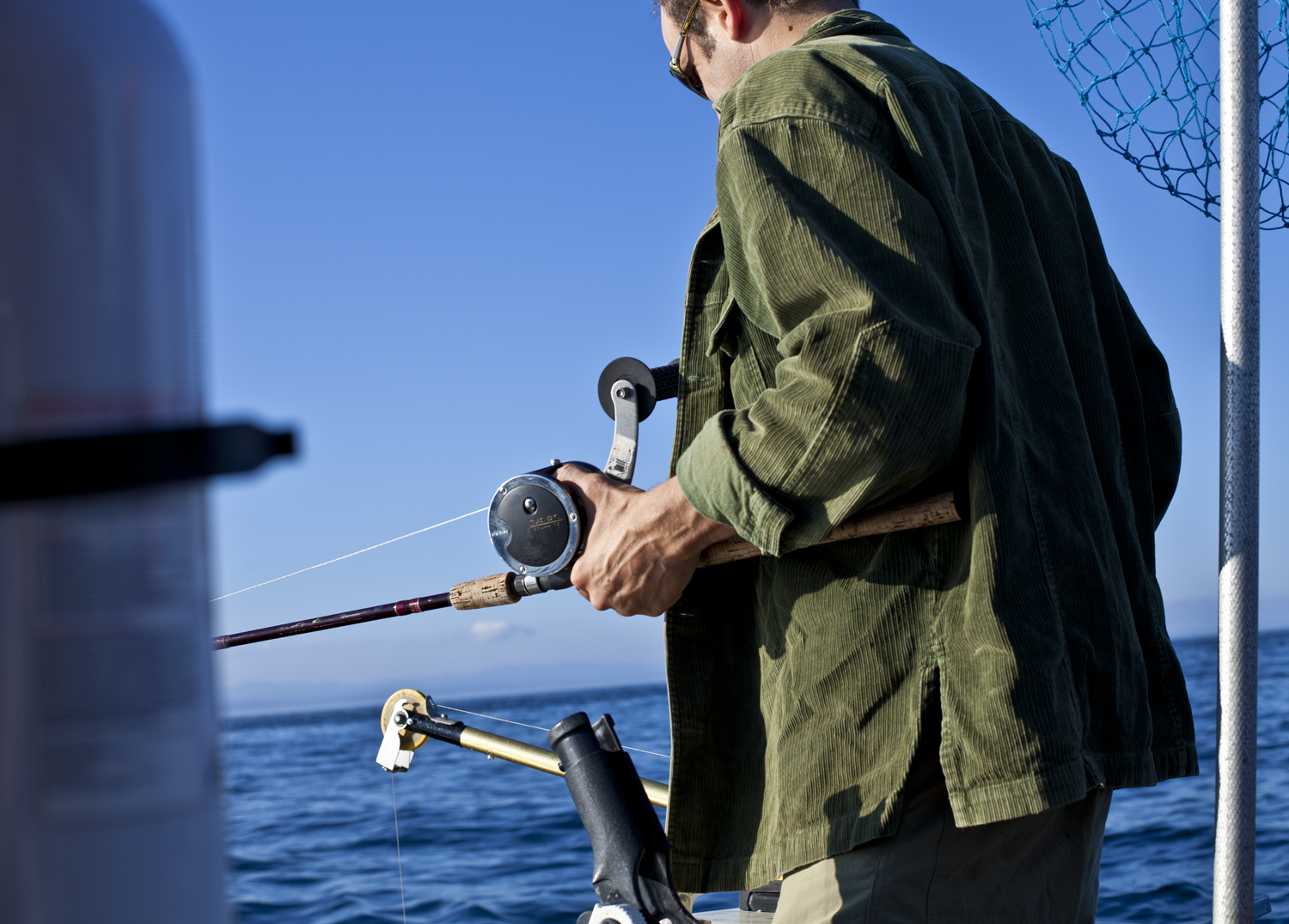 Steve preparing a rod while salmon fishing in the Strait of Juan de Fuca.