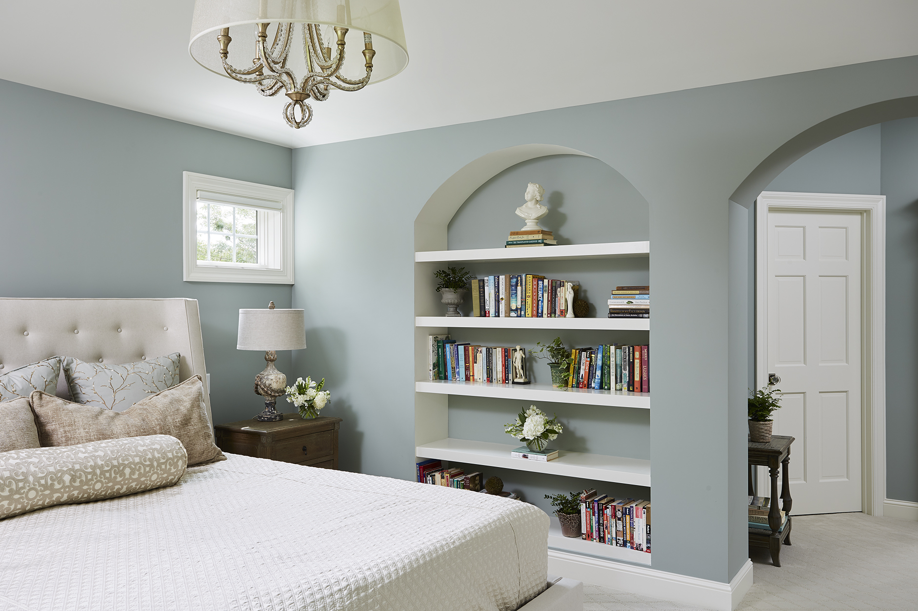 chandelier-arched-bookcase.jpg
