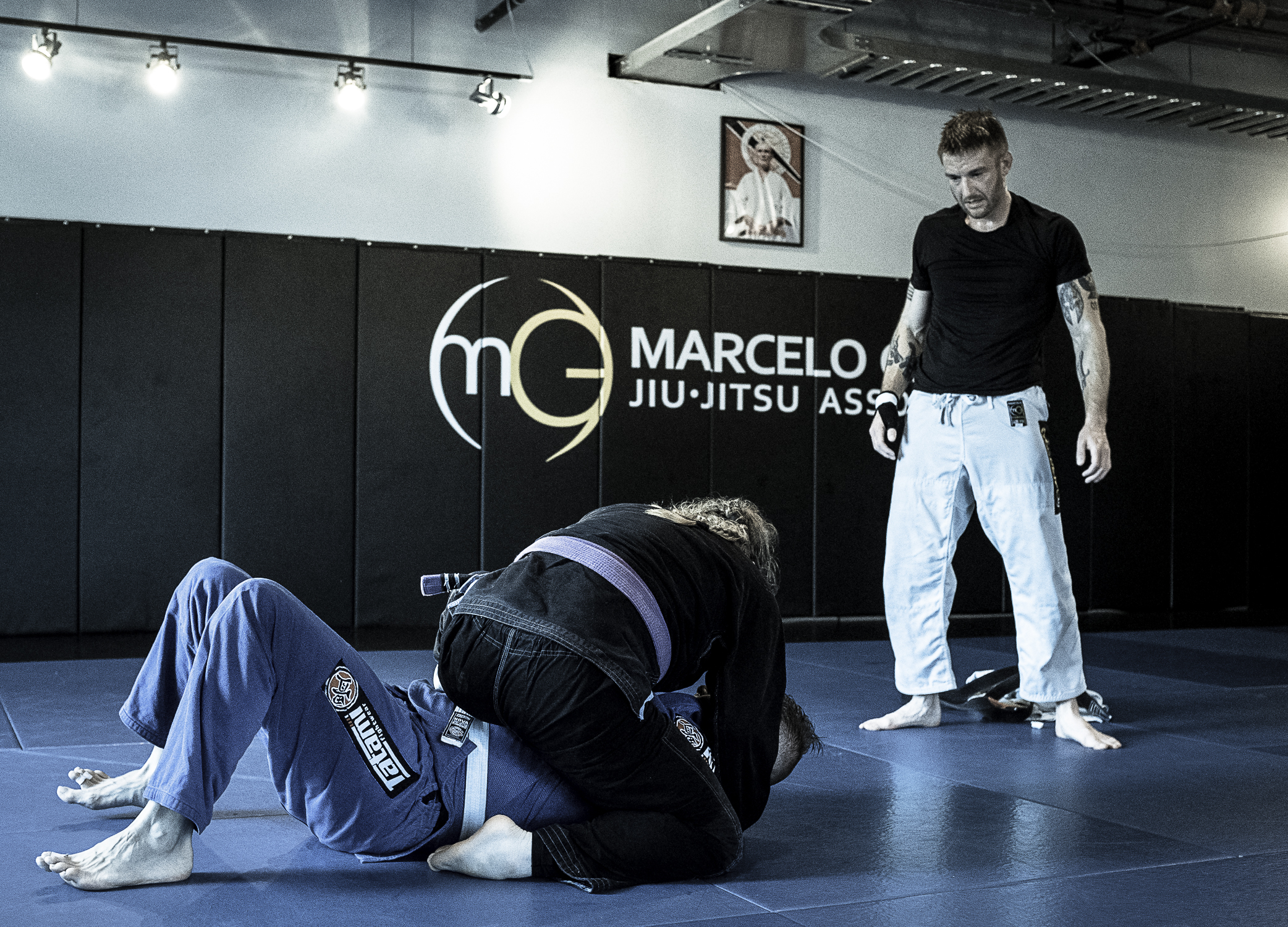 Black Belt, Josh Butia, coaching Purple Belt Josh Sroka