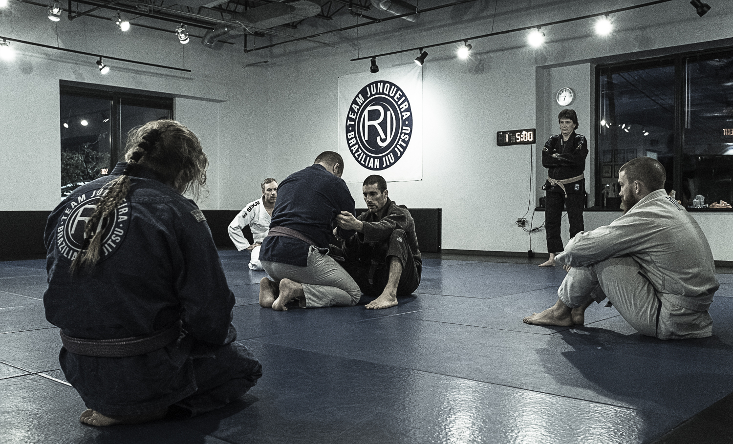 Chris Dube - Brown Belt   Chris Dube is a brown belt who teaches the children's competition classes as well as the noon adult classes. Before joining Team Junqueira in 2015, Chris trained at Gracie Barra Orlando under Marcio Simas. Chris is also a former NCAA Division 1 athlete and is a black belt in Taekwondo under Grandmasters T.H. Kim and Young Bo Kong.
