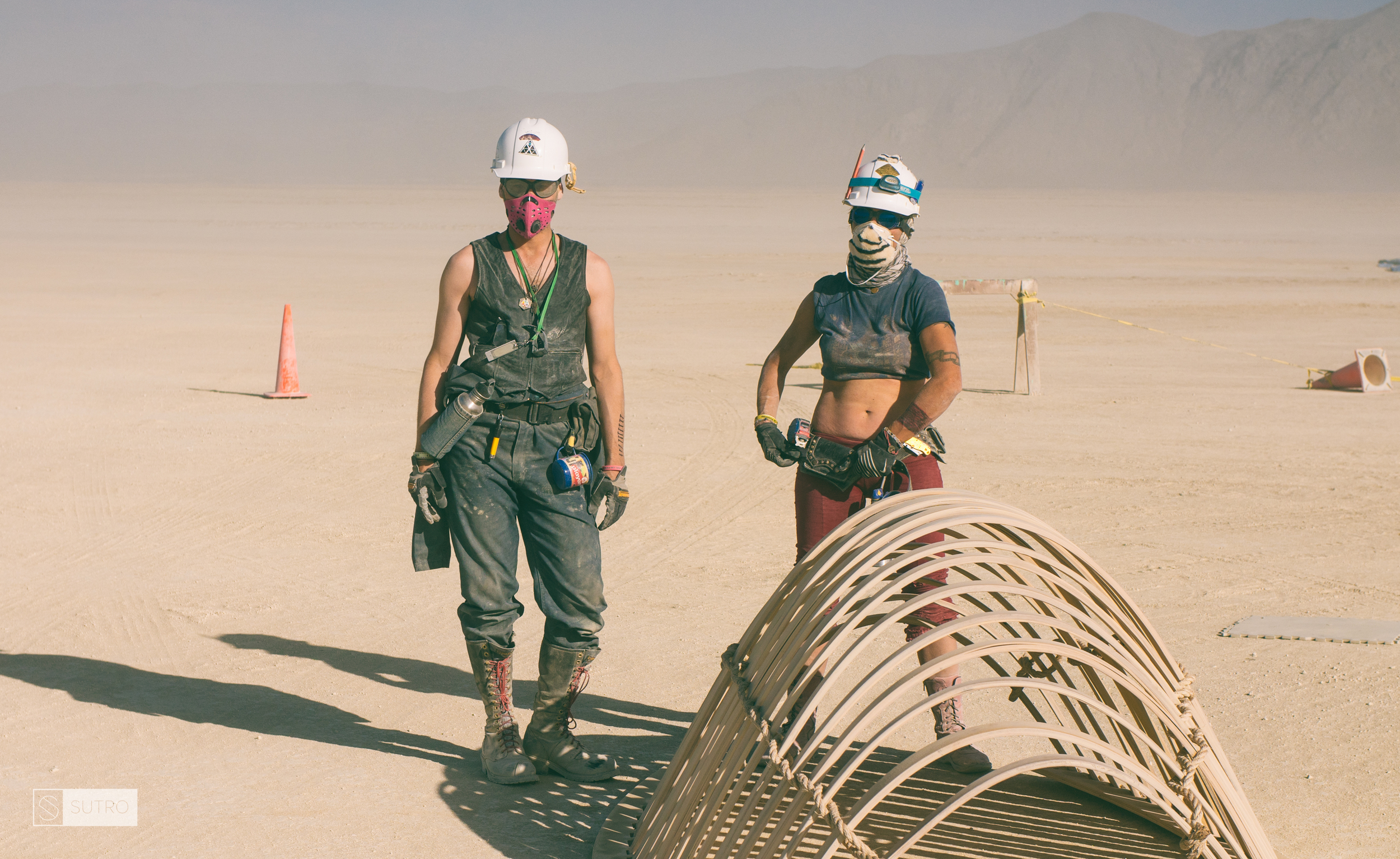 Temple crew members give their heart and soul to the project. Michelle Strecker and Klaudia Kenny breathing through dust masks to make sure they can keep working through all kinds of adverse weather conditions.