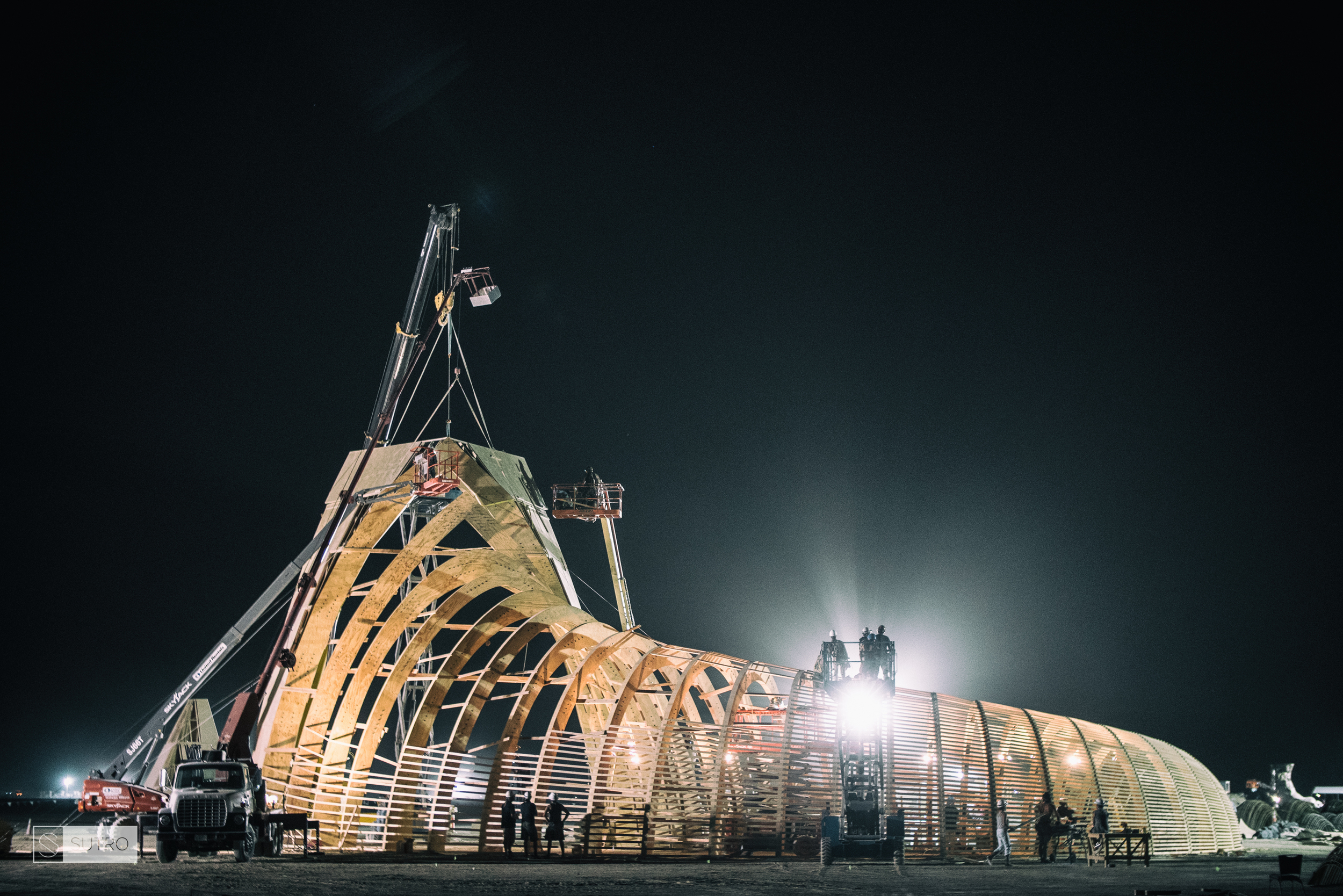 Flood lights illuminate everything so that night crew members can keep working. At this point, 24/7 crews work tirelessly to make sure construction runs as smoothly as possible.
