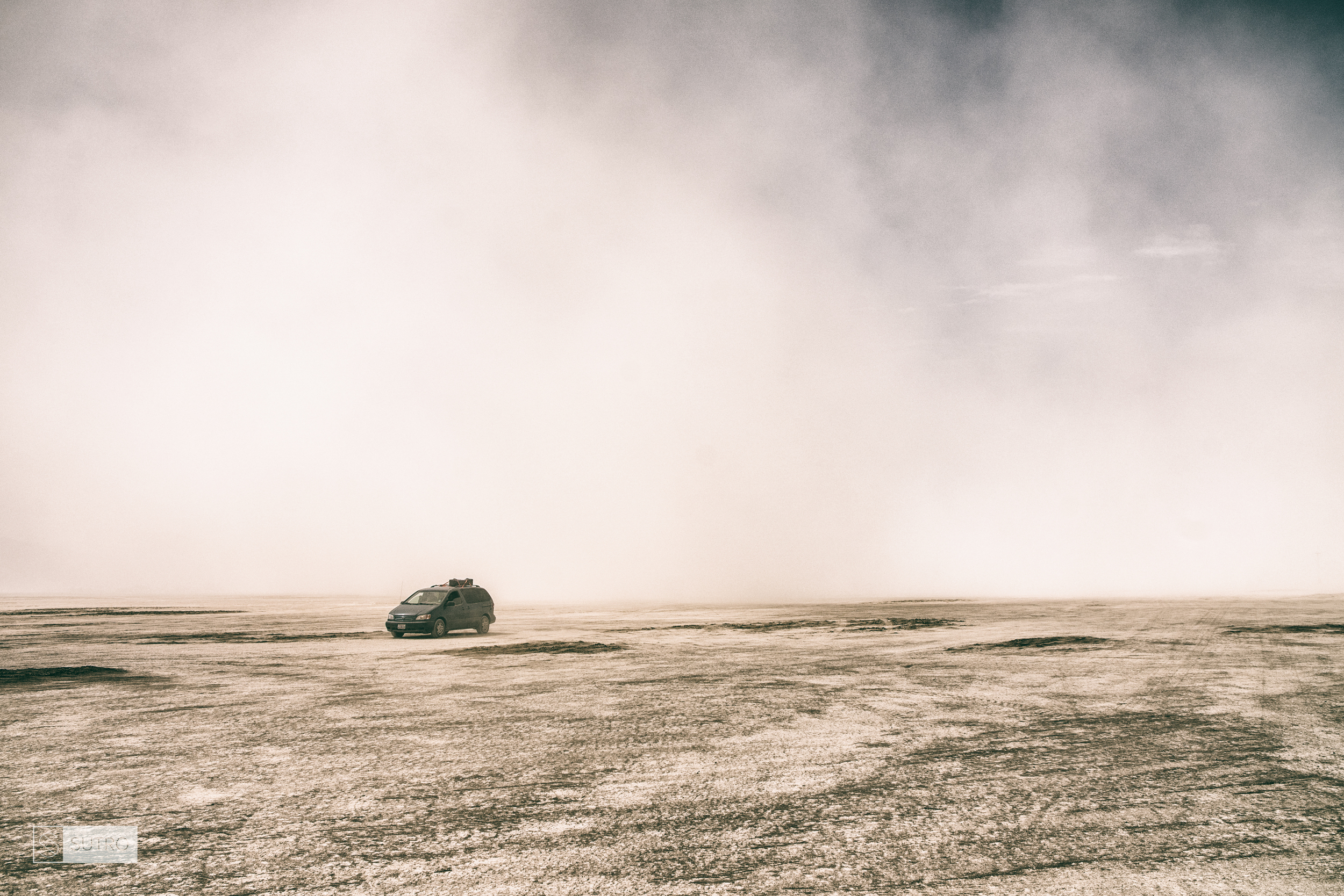 Typical dust storm on the Playa quietly approaching a car close to the Temple of Promise construction site.