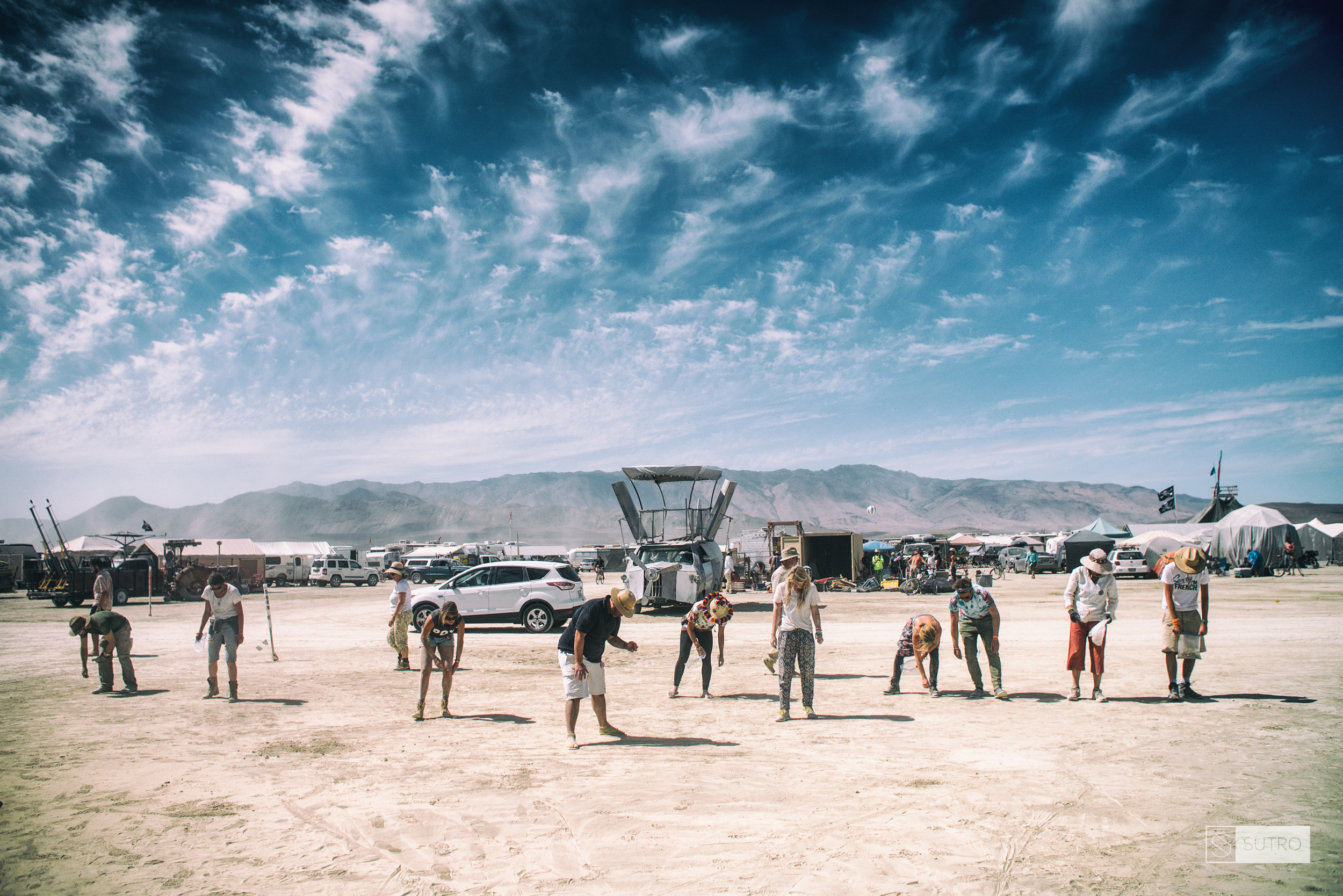 Members of FAFA camp do a final cleanup of the site before leaving the Playa at the end of the event.