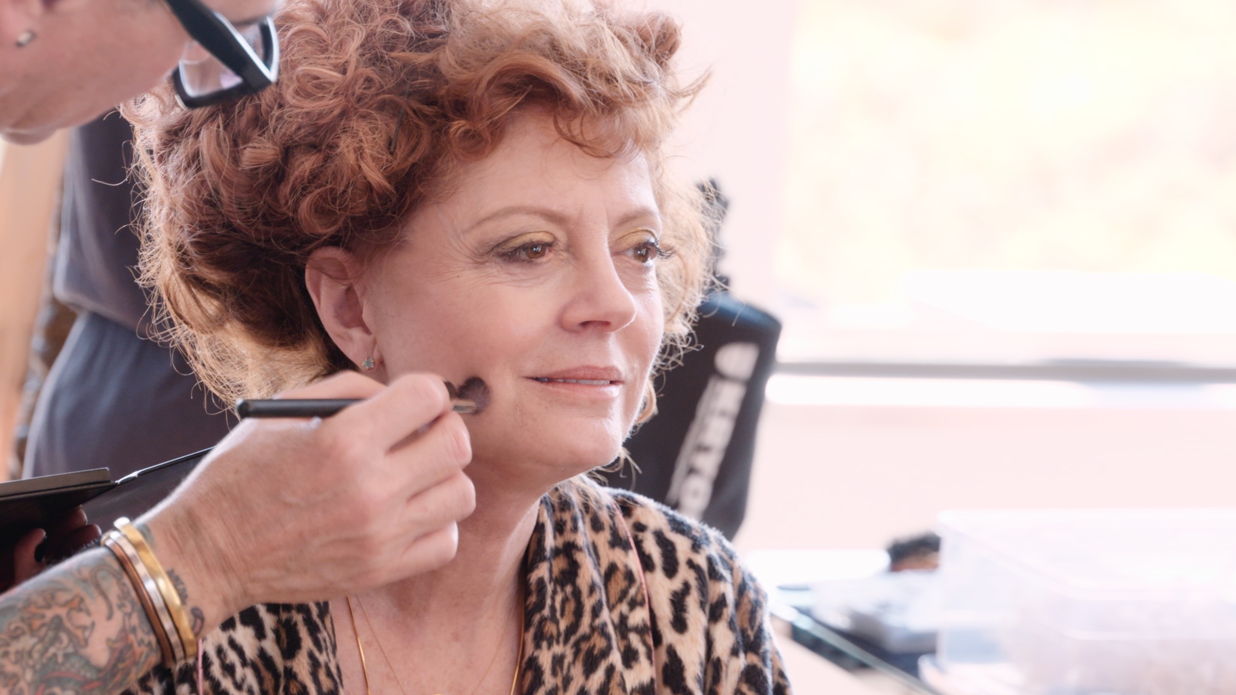 Susan Sarandon getting ready for the photoshoot by Michael Garlington. David Reposar and Lonnie Rivers did her makeup and hair for the shoot.