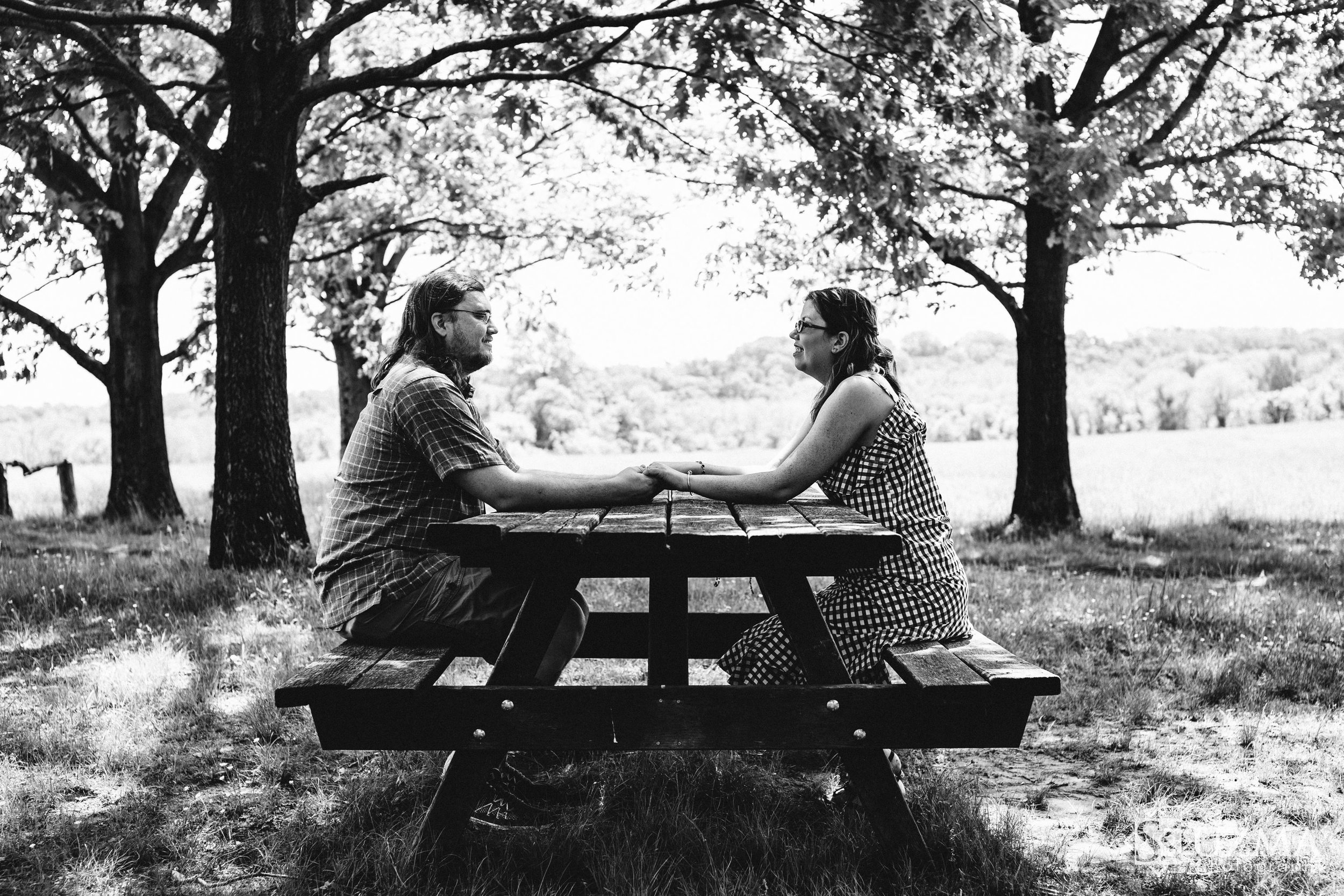 Liz and Andrew on a park bench