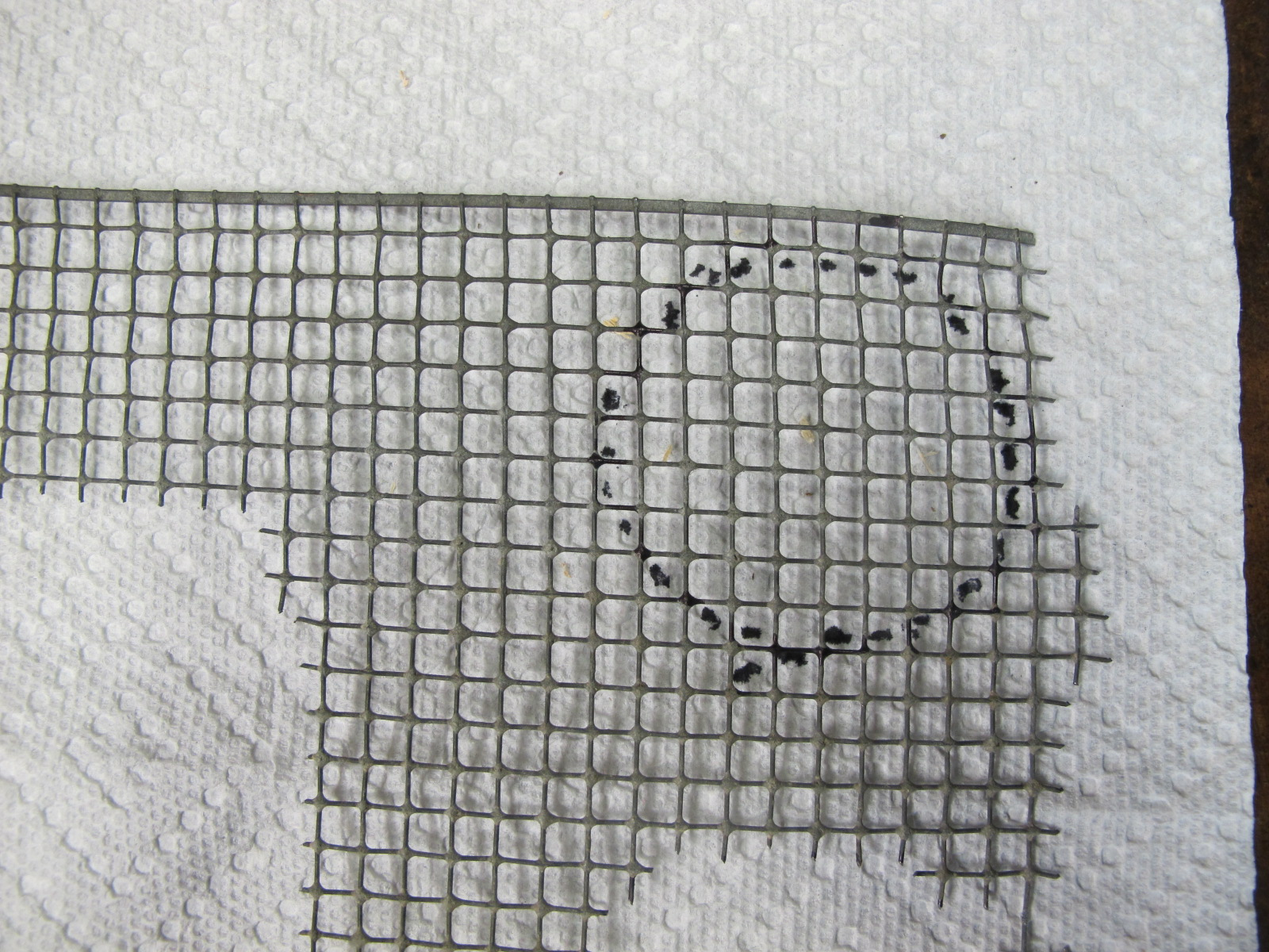 Cut out patter on wire mesh.