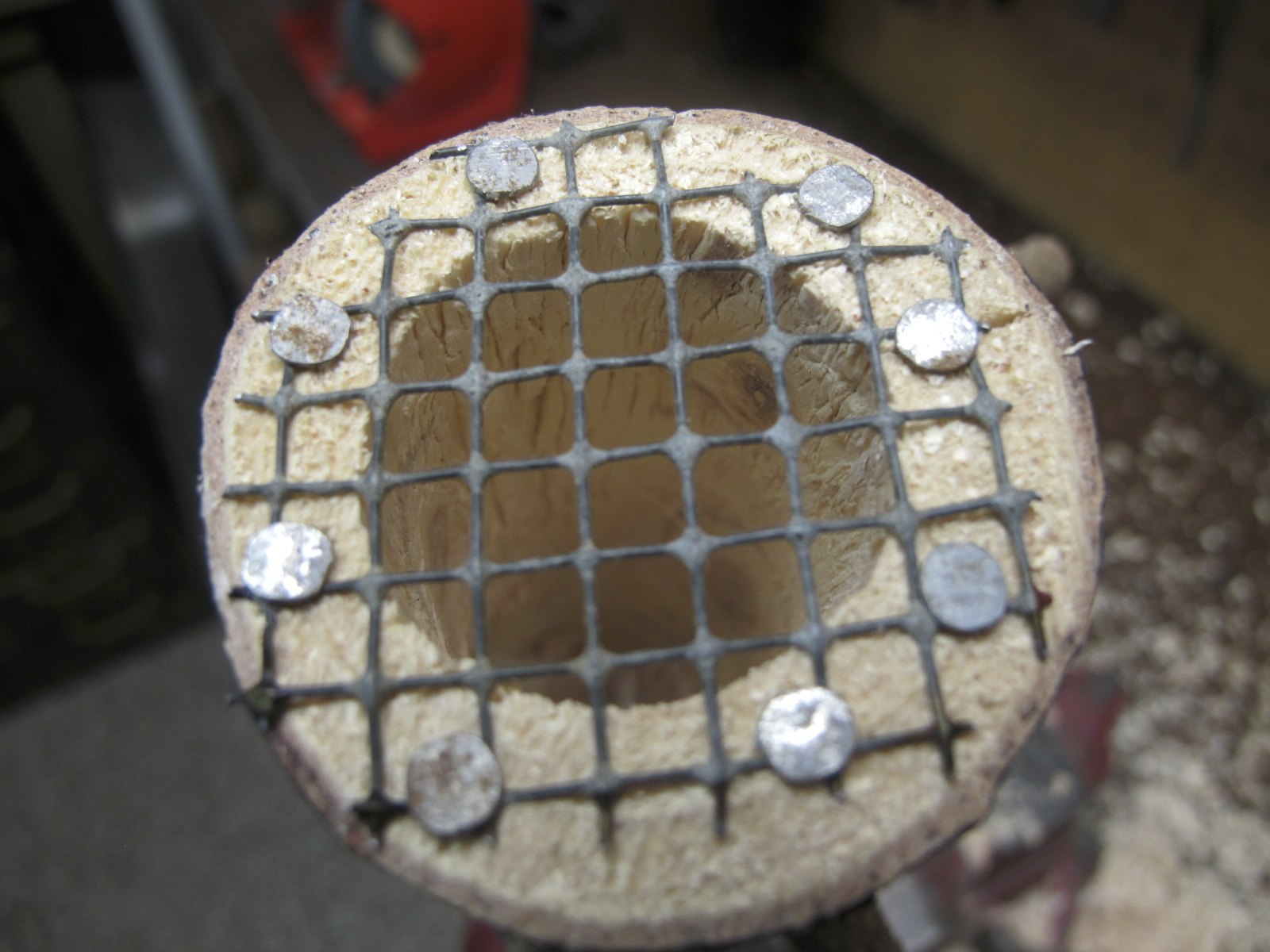 Attach wire mesh bottom using small broad headed nails or tacts to secure into place.