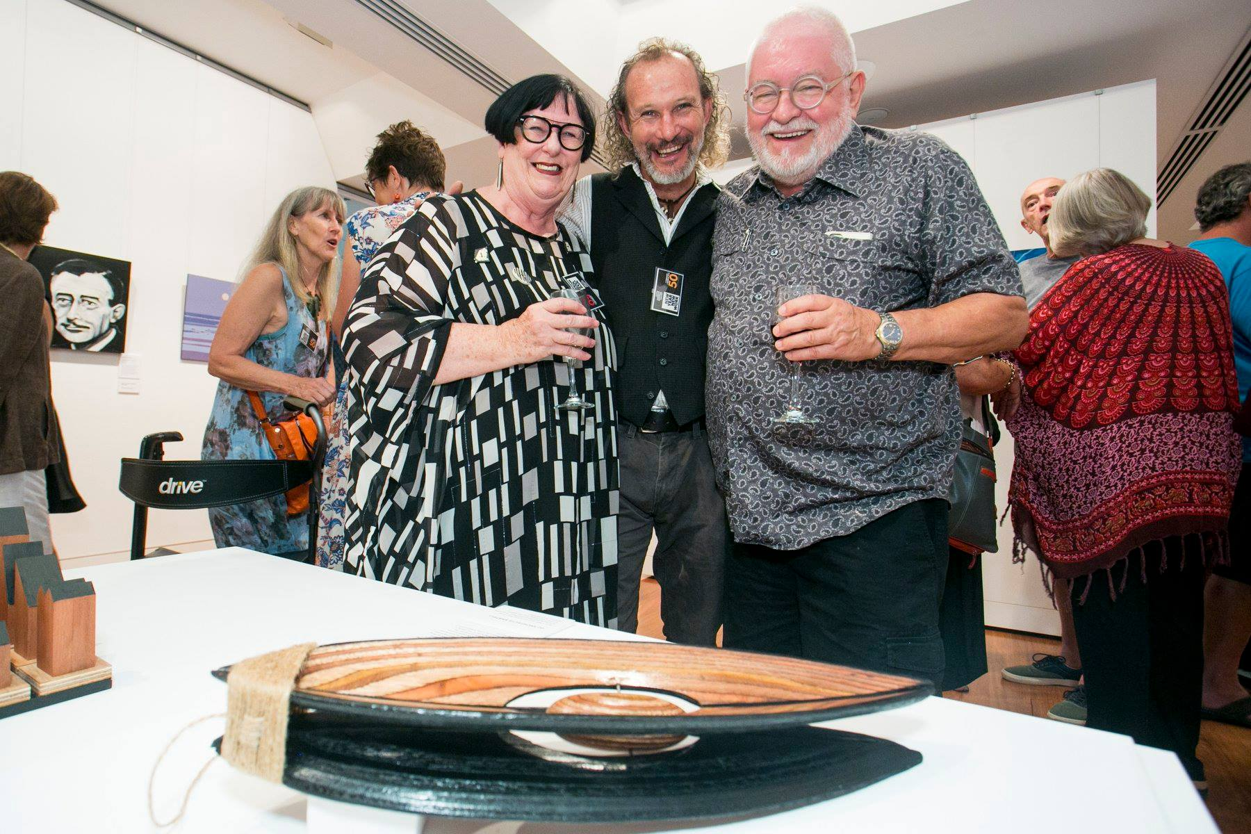 "g2's Ann and Alan Gee with local Artist Jeramie Scahill and his sculptural work ""Plumb Bob"""