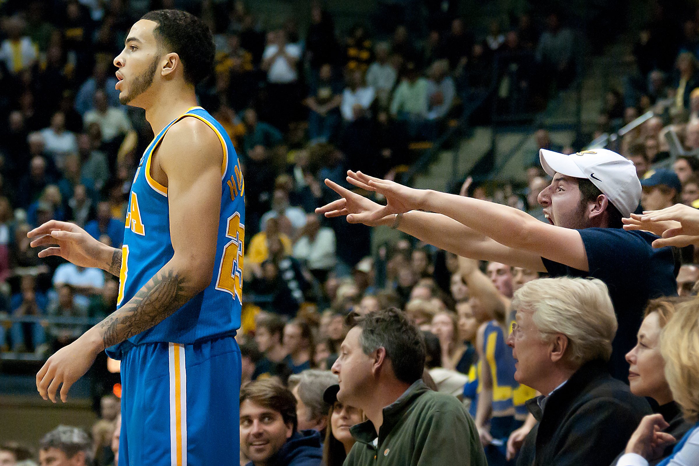 SEATTLE, WA – A fan attempts to distract Sophomore forward Tyler Honeycutt during an inbound play at Bank of America Arena on Thursday, March 3, 2011.