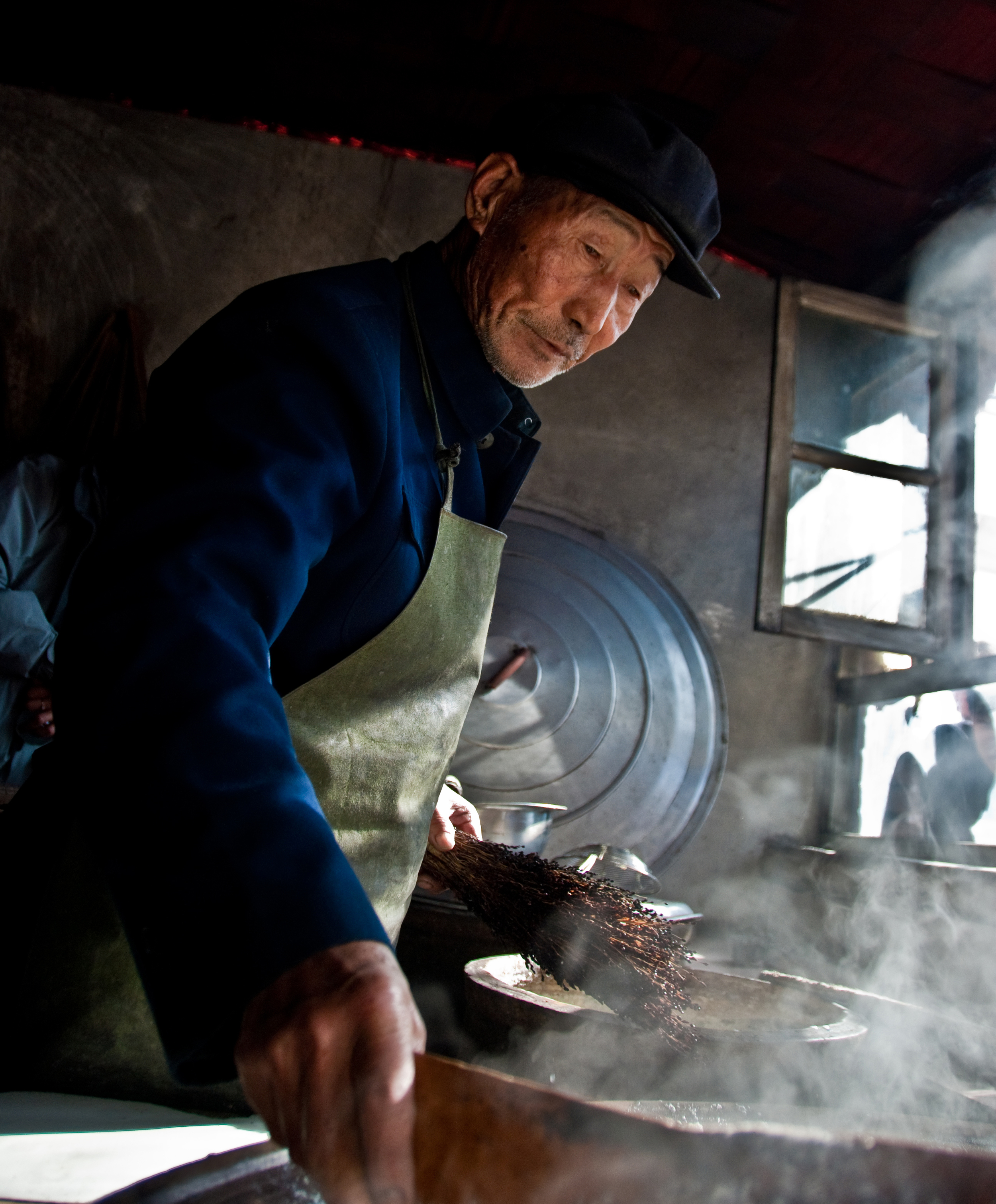 BEIJING, CHINA – A tofu maker in the rural outskirts of Beijing readies a batch of tofu in March 2009.