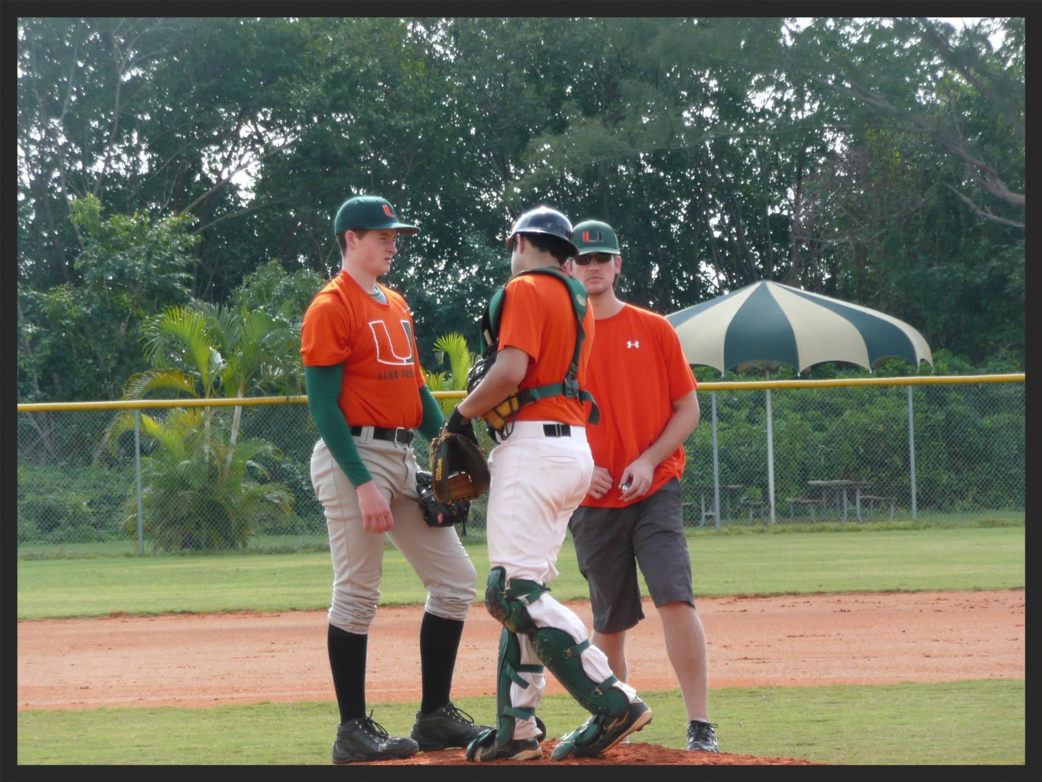 Pitcher Dan Briggi, catcher Matt Fernandez, and head coach Mike North talk pitching during the fall.
