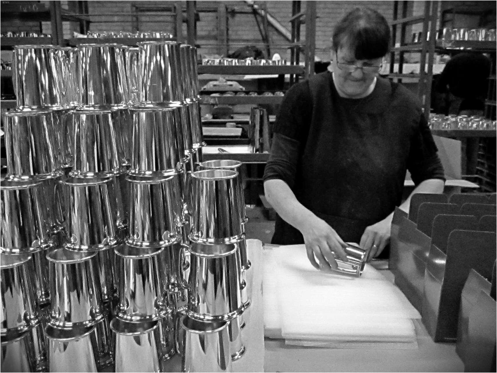 Polished tankards being packed by Sandra Slowe