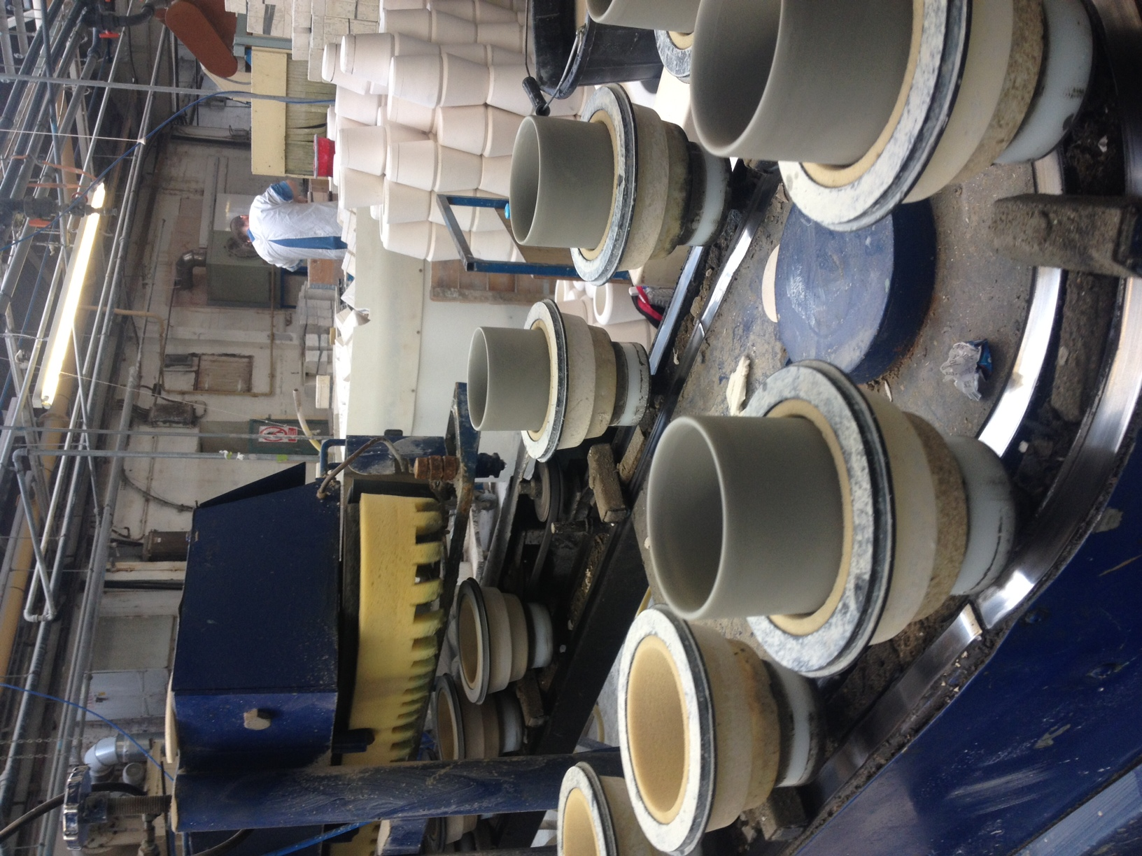 cup production, see the turreted sponge cleaning up the top of the cups