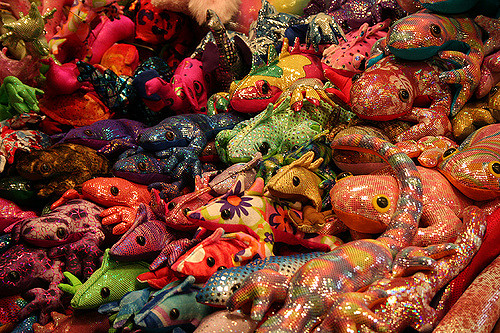 Visit Mao Thao's Cloth & Fiber art booth that includes a whole wall of sand-filled, hand-made animals
