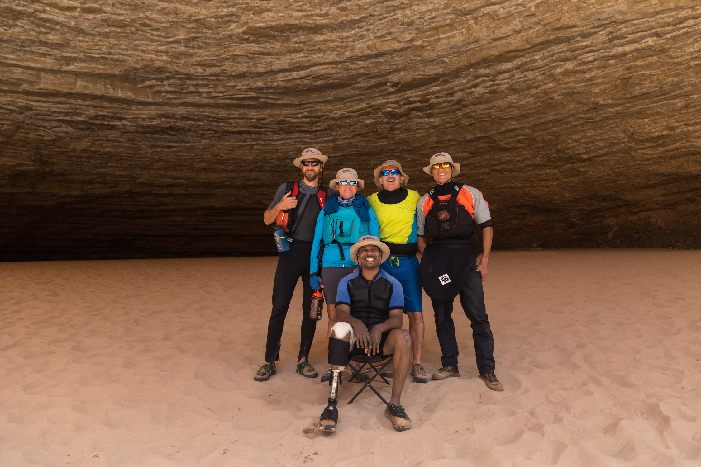 Group photo of all the disabled veteran kayakers in Redwall Cavern.