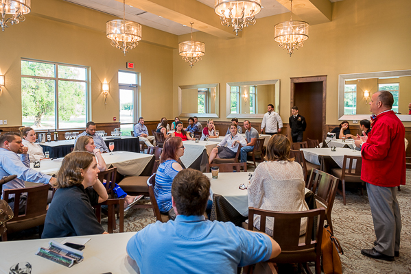 Alumni gather for a meeting in one of Bistro Ruth's dining rooms.