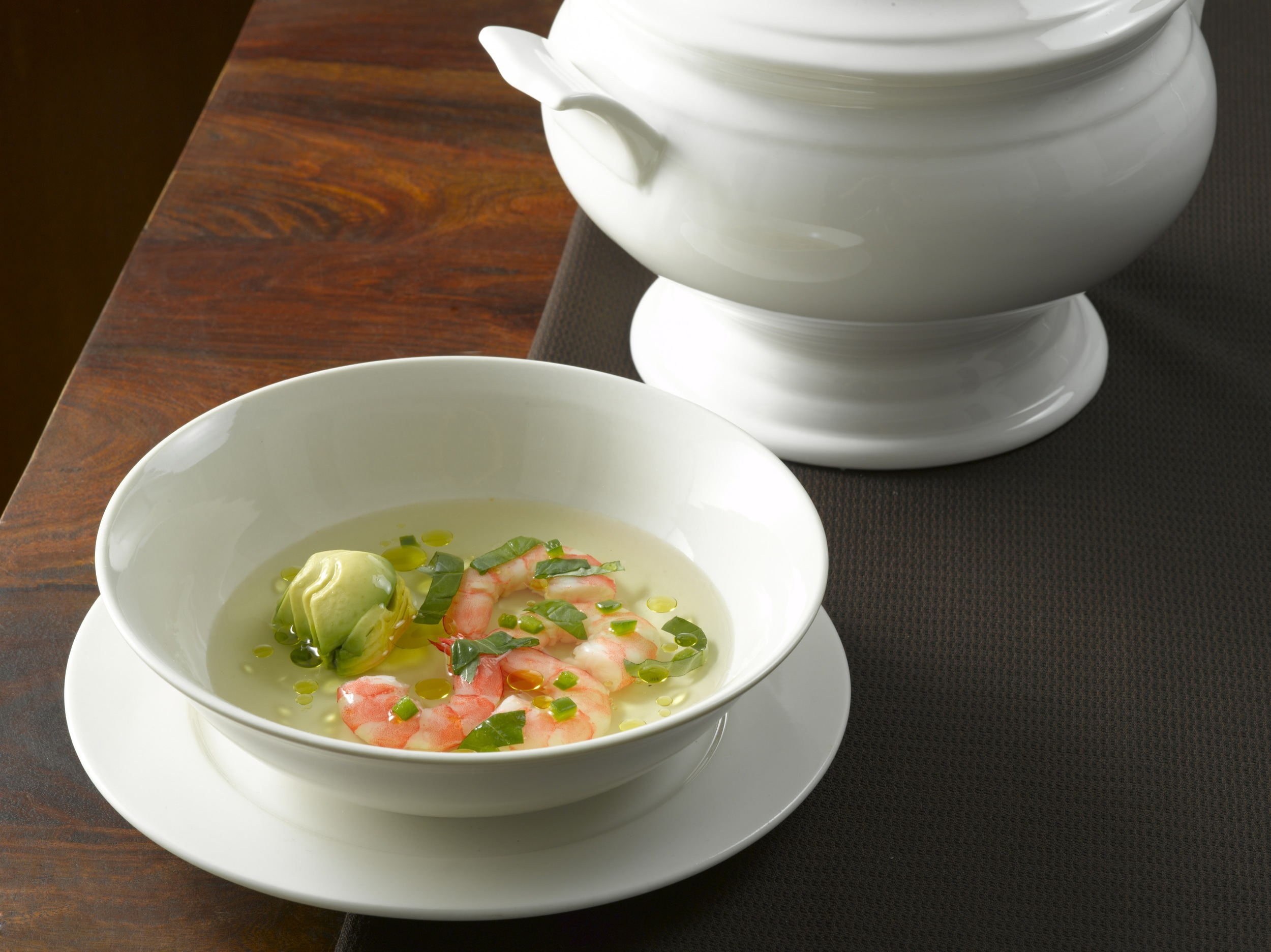 Tomato Consomméwith Basil and Lemongrass  : A light-bodied and pure blend of simple flavors, at once sweet and acidic.