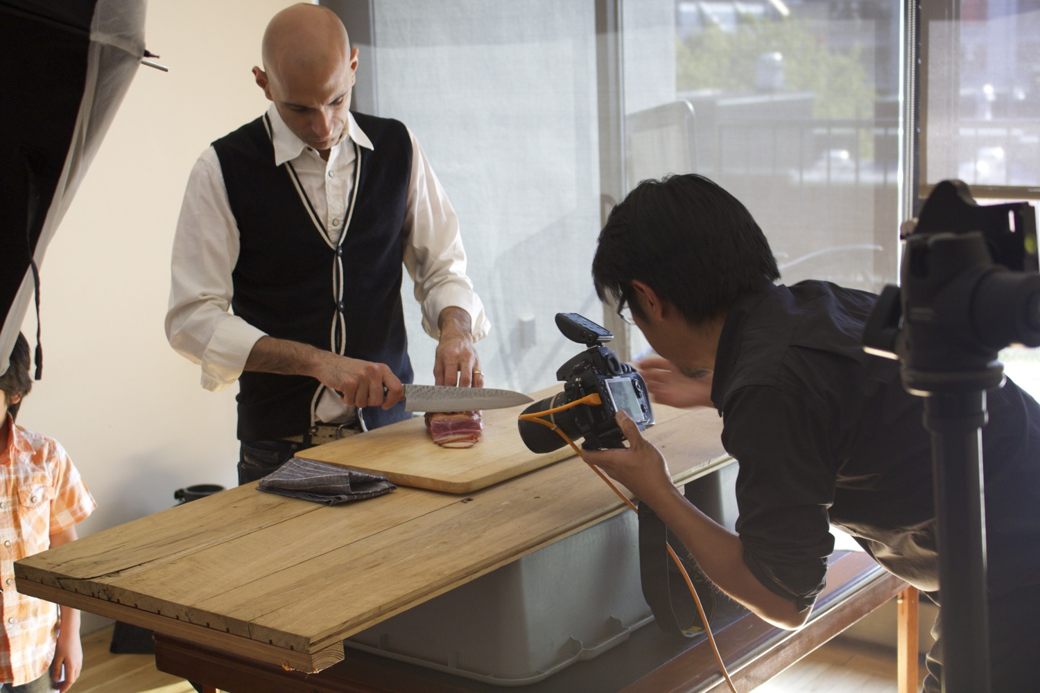 Chef Jehangir Mehta on set with photographer Evan Sung