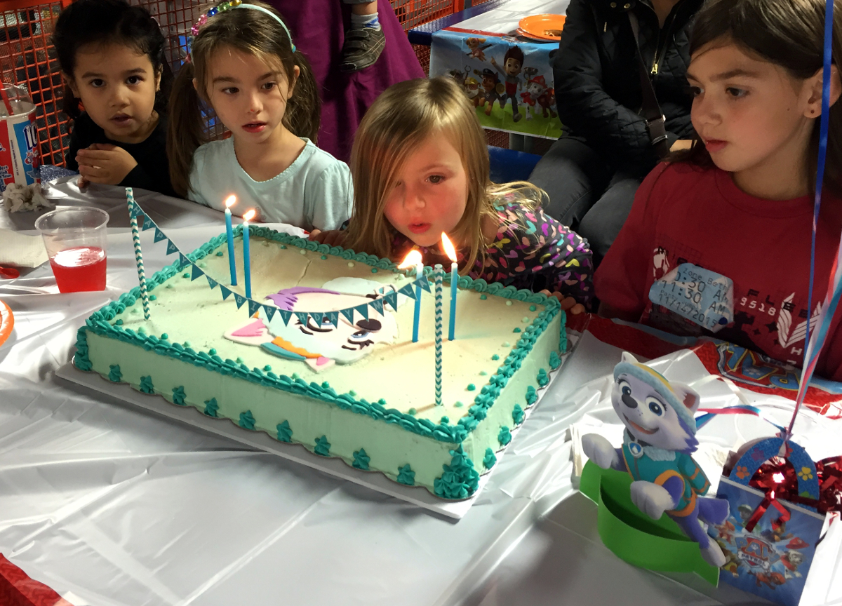 Myla blowing out her candles.