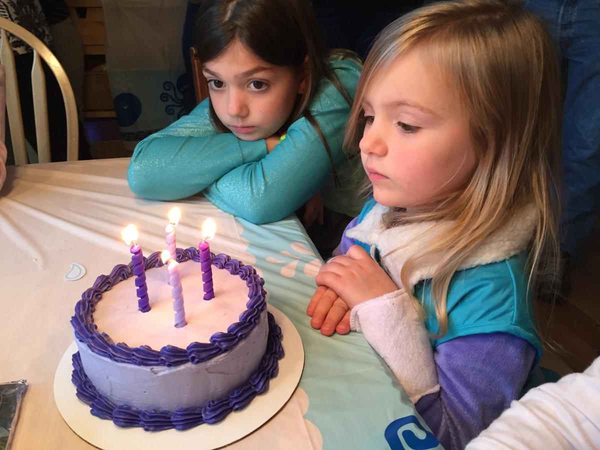 Myla with her purple cake.