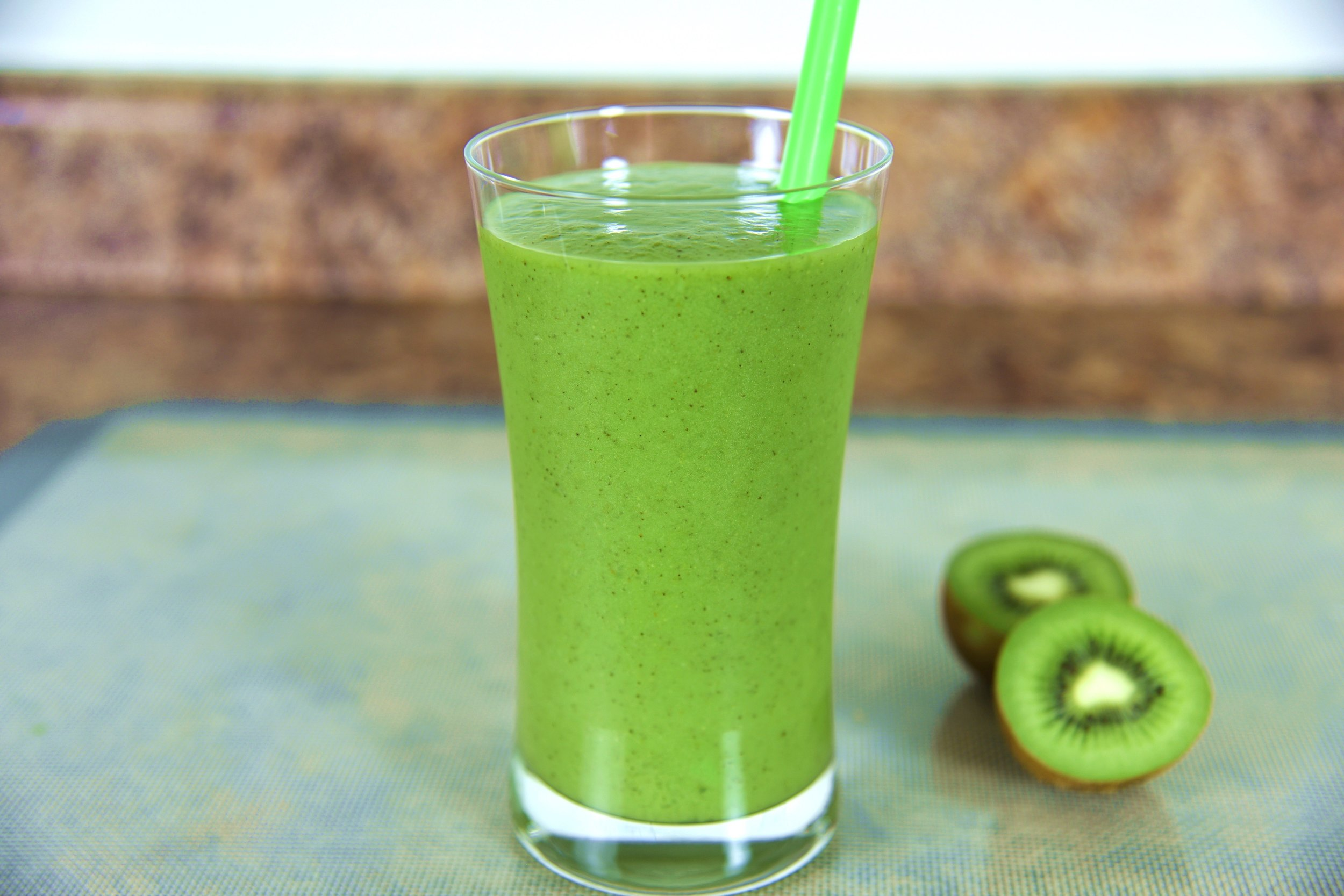 Kiwi-Froosion Smoothie. Made with fresh Kiwifruit, Pears, Celery, Avocado and Spinach.