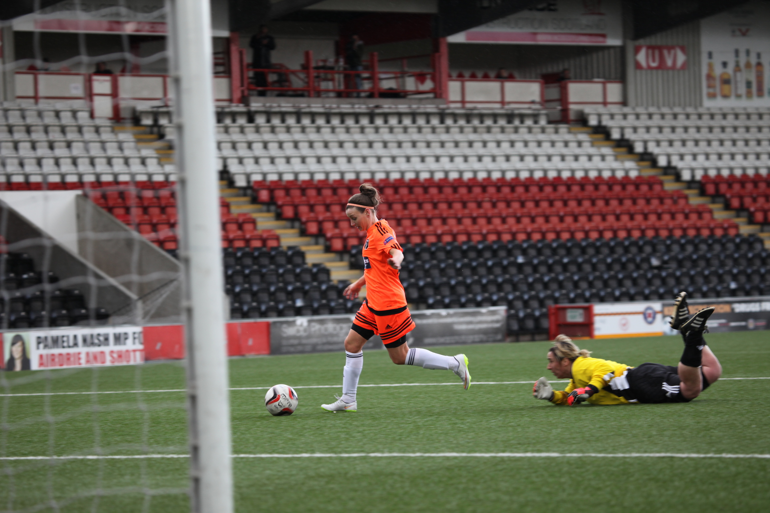 Susan Fairlie rounds Kim Jappy for her 4th goal of the day.jpg