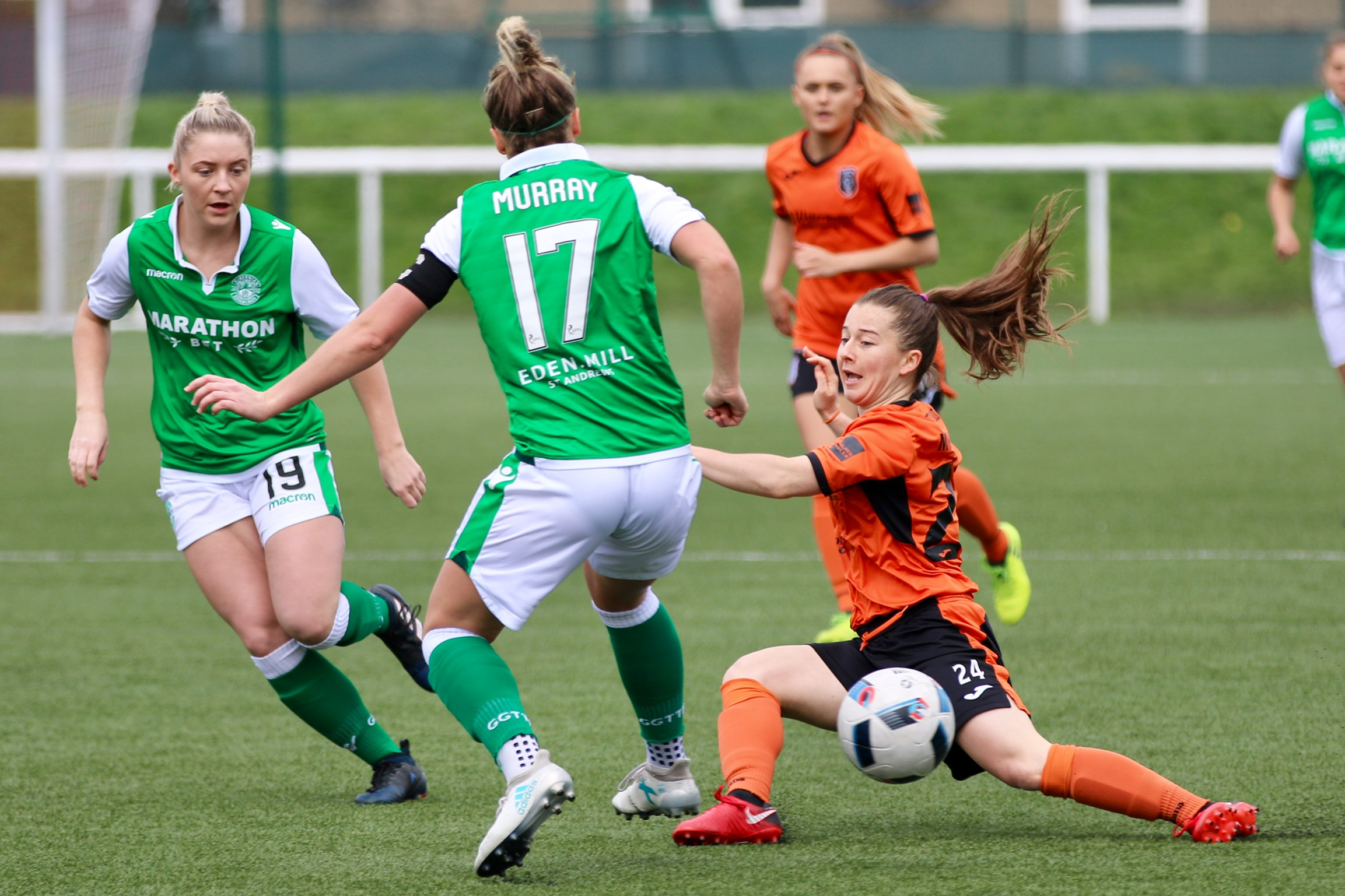 Christie Murray (City) and Joelle Murray (Hibs) compete for the ball.jpeg